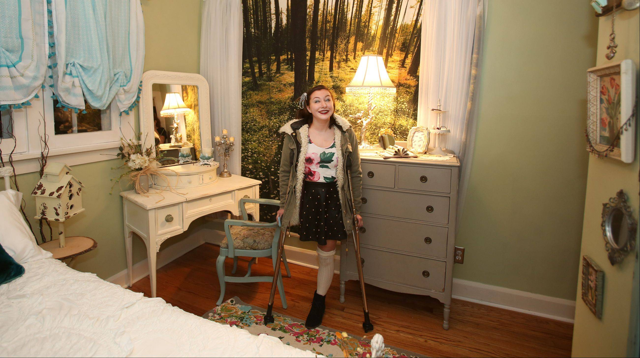 Genevieve Cipriano, 18, of Glen Ellyn looks over her bedroom, designed by Special Spaces Chicagoland, a Naperville nonprofit organization that creates dream bedrooms for children with life threatening medical conditions.