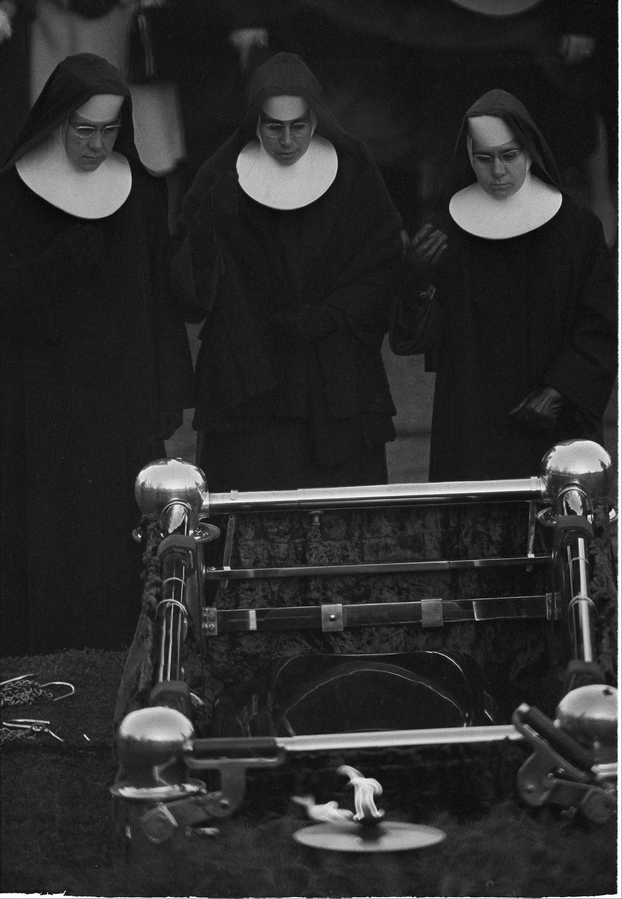 Three Roman Catholic nuns pay their final respects at the grave of President John F. Kennedy at Arlington National Cemetery, Nov. 25, 1963. Kennedy was the first Roman Catholic elected to the presidency.