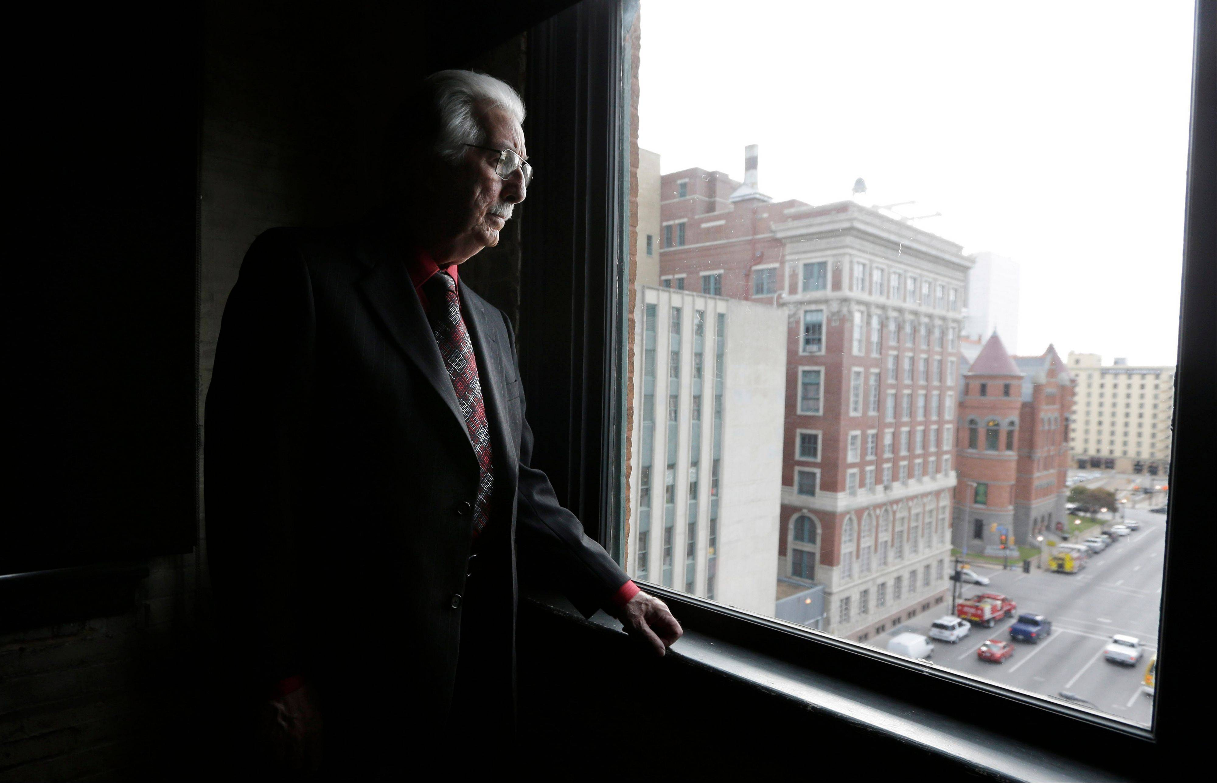 Buell Wesley Frazier looks out onto Dealey Plaza from a window on the seventh floor of the Texas School Book Depository building in Dallas on Thursday. Frazier was a co-worker of Lee Harvey Oswald at the depository and gave him a ride to work on the day of the assassination of John F. Kennedy.
