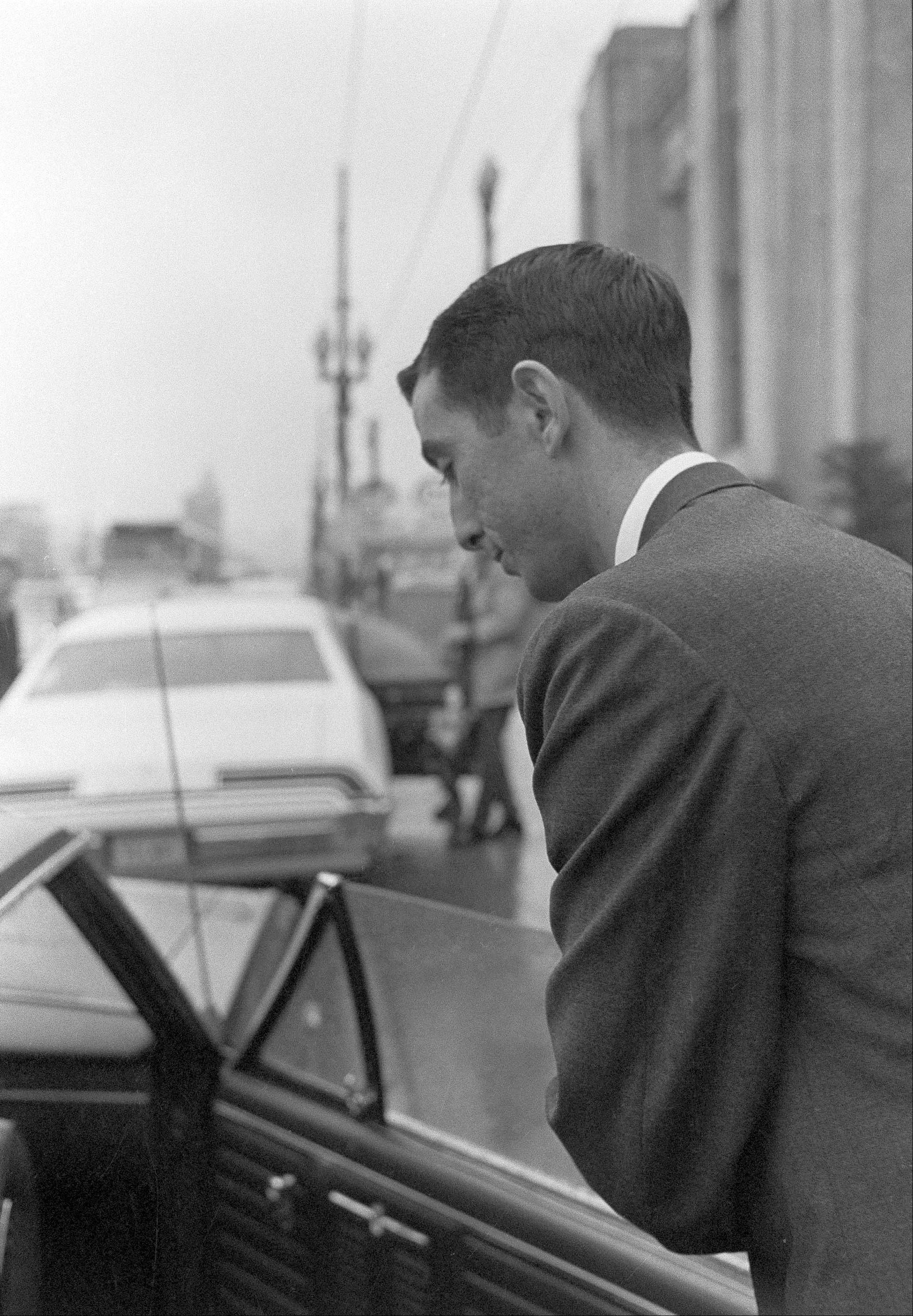 Buell Wesley Frazier of Irving, Texas, a co-worker of Lee Harvey Oswald at the Texas School Book Depository in Dallas, leaves court after testifying in the Clay Shaw trial in New Orleans.
