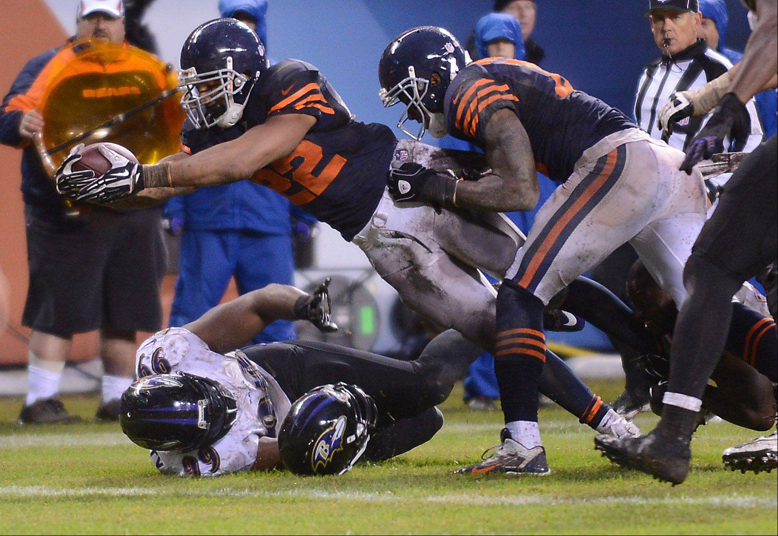 Chicago Bears running back Matt Forte (22) dives for the end zone and a fourth-quarter touchdown against the Ravens during Sunday's game in Chicago.