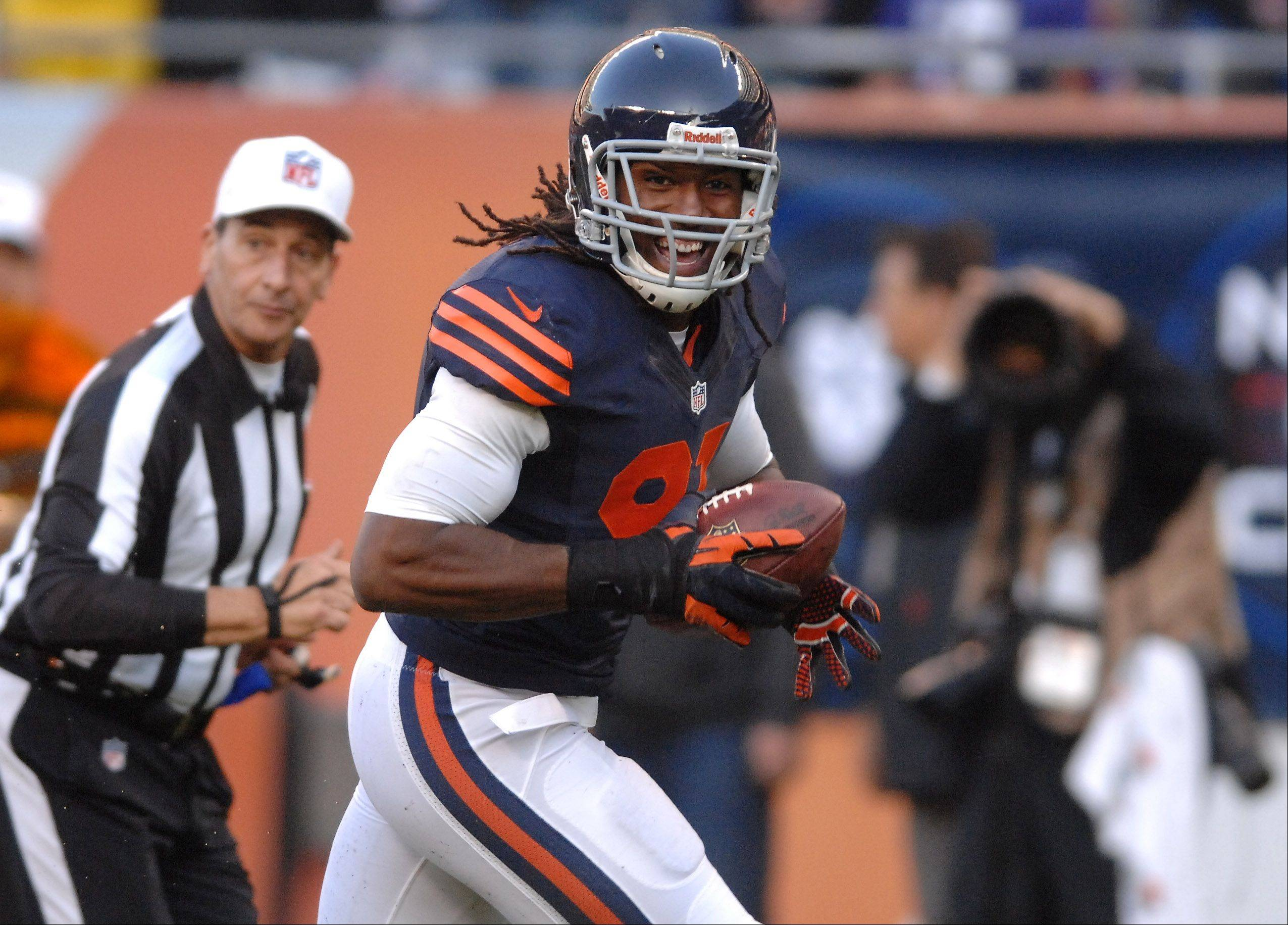 Chicago Bears defensive end David Bass (91) smiles as he runs untouched into the end zone after his interception during Sunday's game in Chicago.