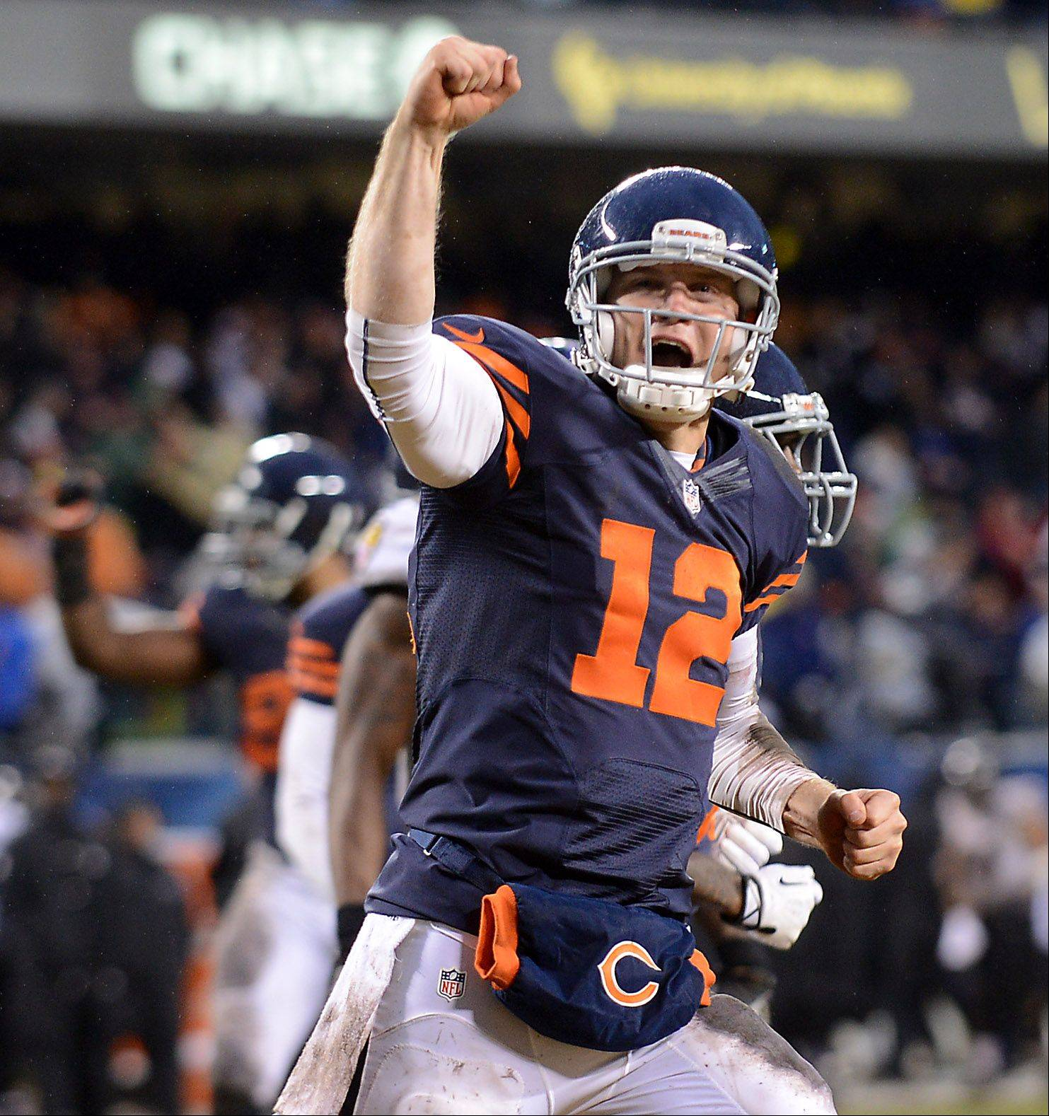 Chicago Bears quarterback Josh McCown (12) pumps his fist after Matt Forte's touchdown put the Bears ahead in the fourth quarter during Sunday's game in Chicago.