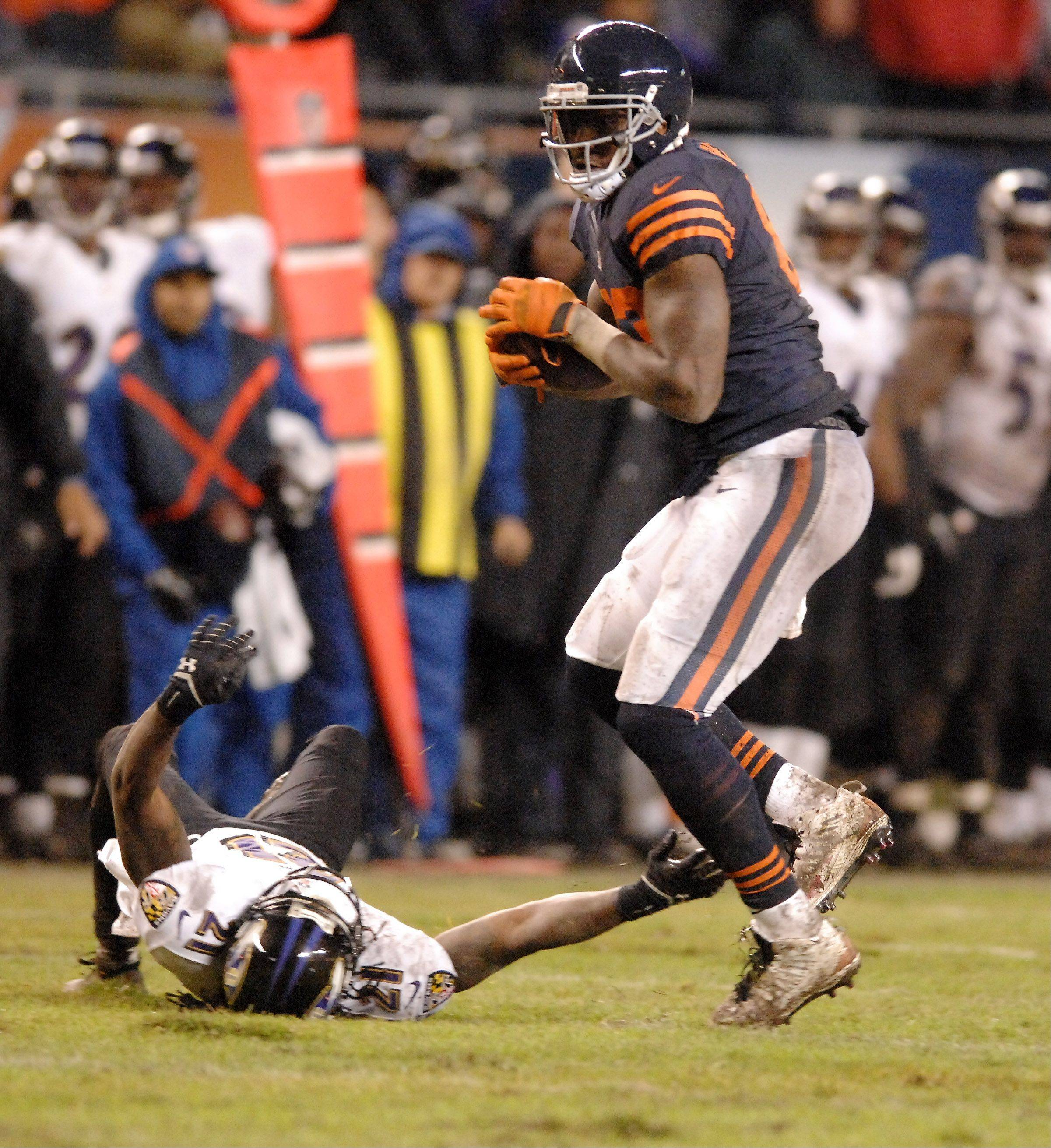 Chicago Bears tight end Martellus Bennett (83) hauls in the catch in overtime that help set up the game-winning field goal during Sunday's game in Chicago.