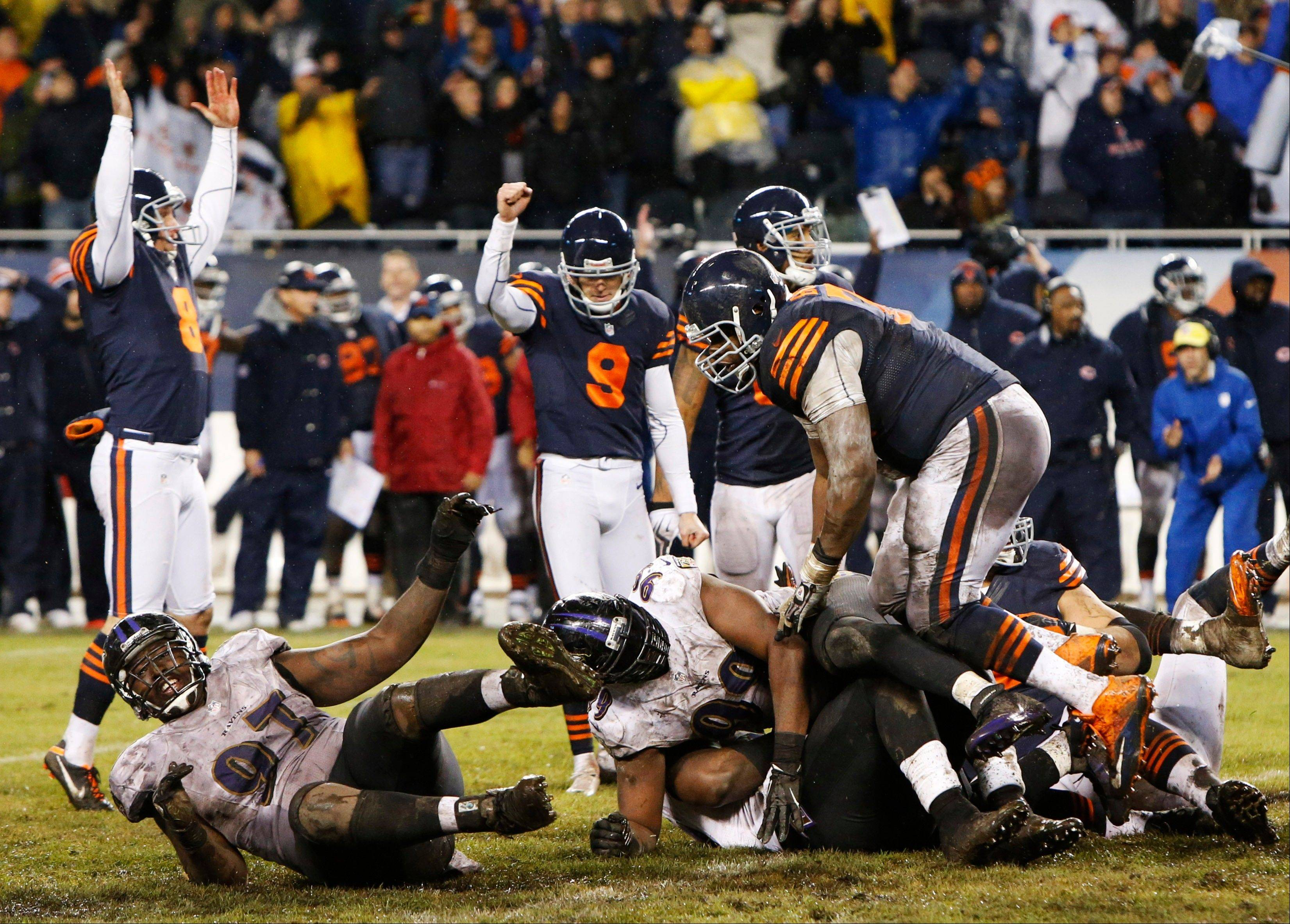 Chicago Bears kicker Robbie Gould (9) celebrates after booting the game-winning field goal in overtime to beat the Baltimore Ravens 23-20 in an NFL football game Sunday, Nov. 17, 2013, in Chicago.