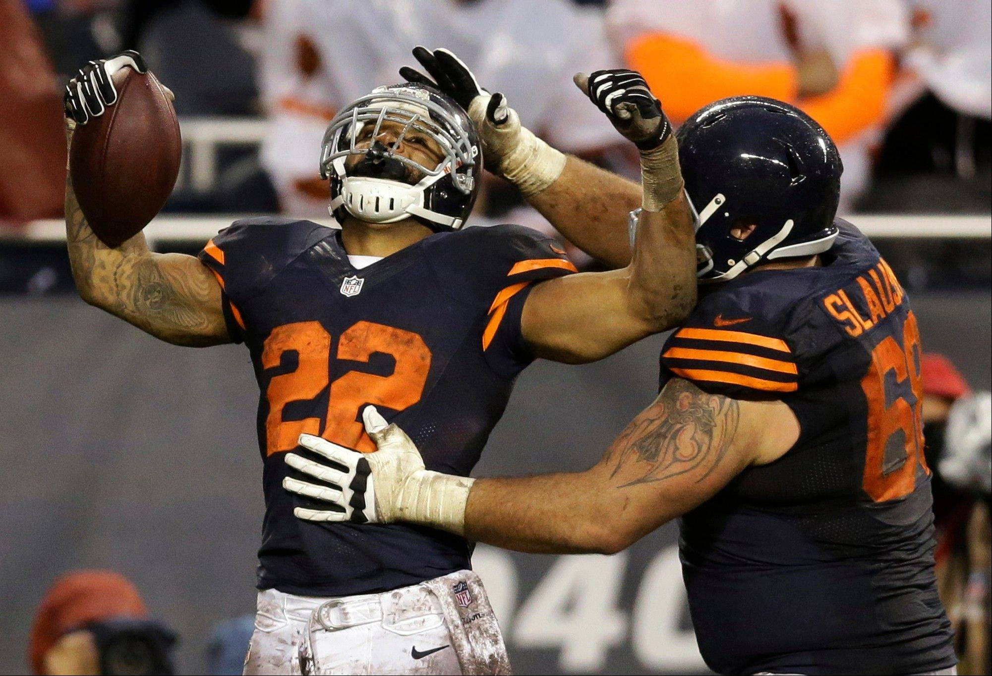 Chicago Bears running back Matt Forte (22) celebrates his touchdown reception with guard Matt Slauson (68) during the second half of an NFL football game against the Baltimore Ravens, Sunday, Nov. 17, 2013, in Chicago.