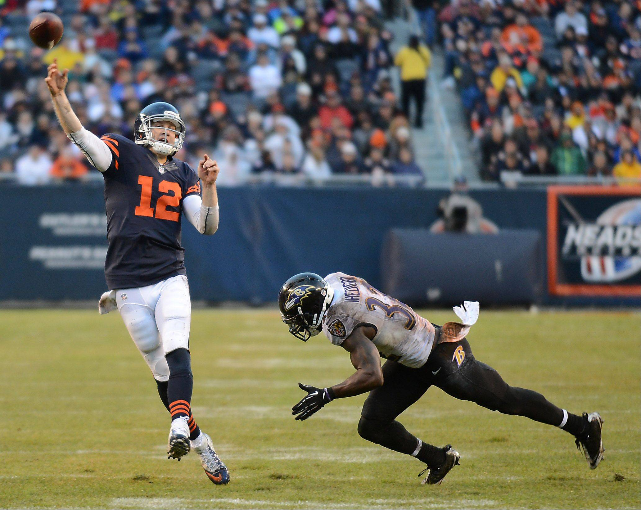 Chicago Bears quarterback Josh McCown (12) rolls out and fires a pass downfield during Sunday's game in Chicago.