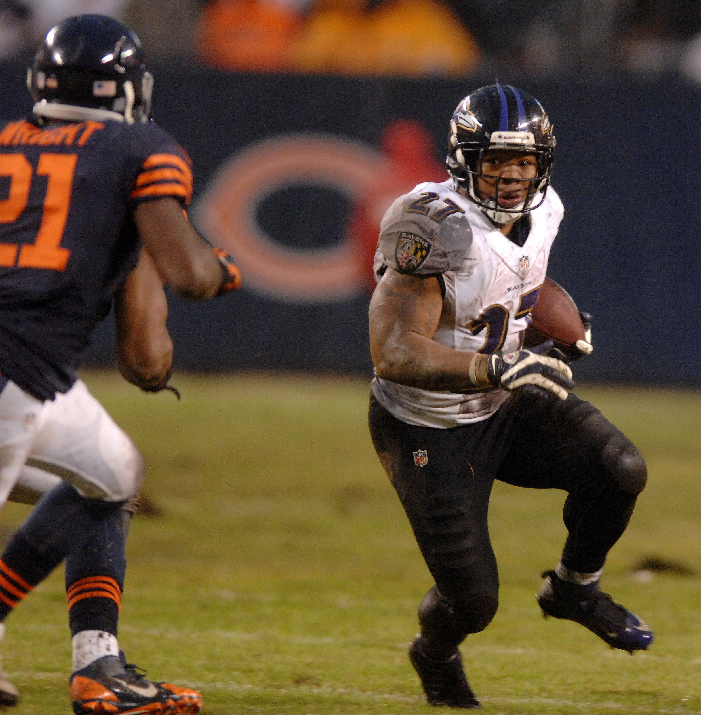 Baltimore Ravens running back Ray Rice (27) breaks a run to the outside as Chicago Bears strong safety Major Wright (21) gives chase during Sunday's game in Chicago.