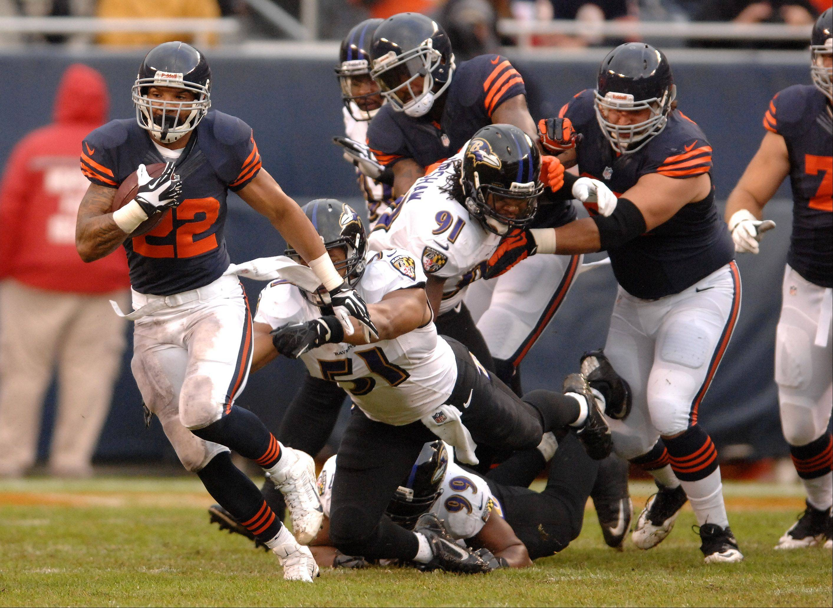 Chicago Bears running back Matt Forte (22) breaks a run to the outside during Sunday's game in Chicago.