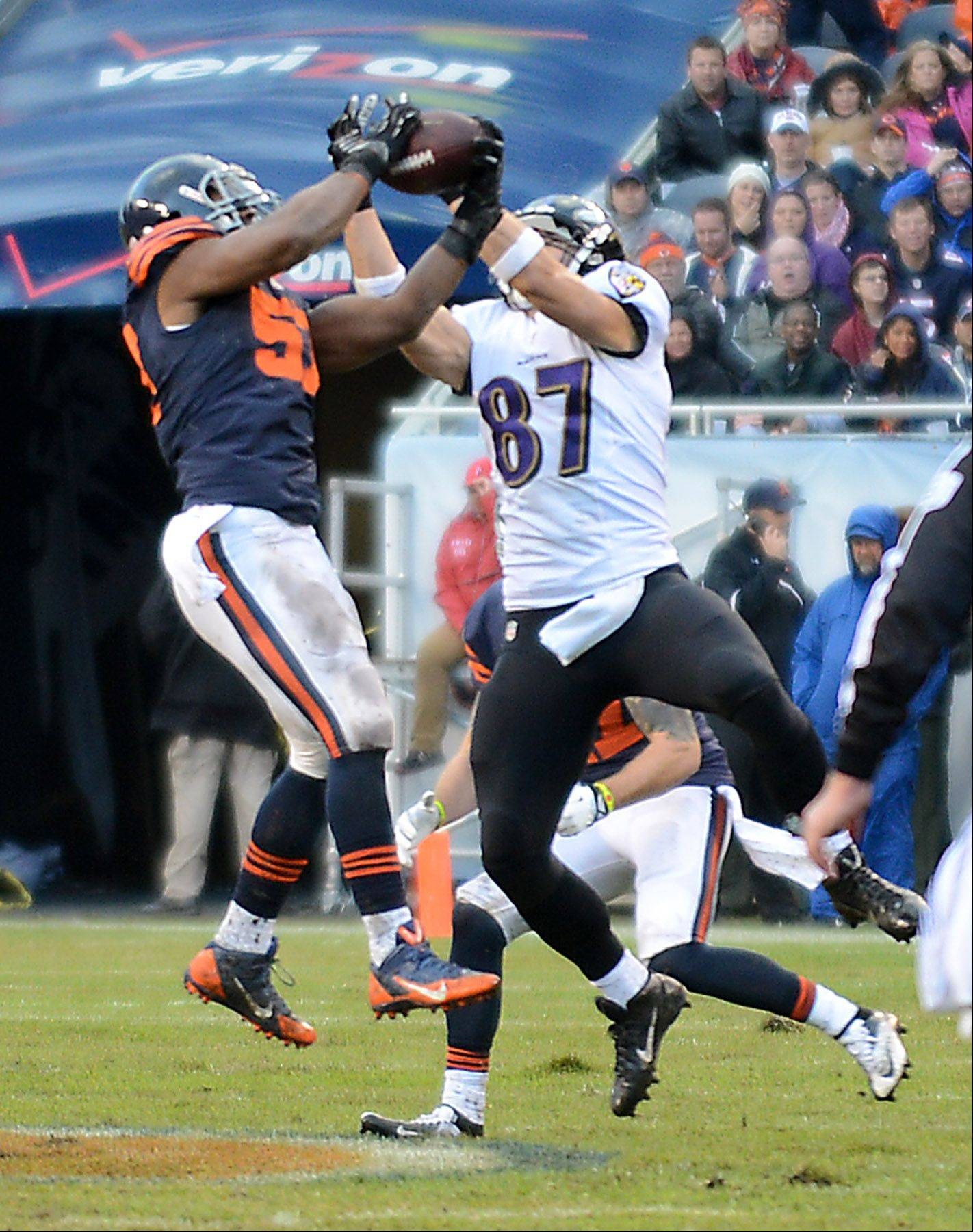 Chicago Bears inside linebacker Jon Bostic (57) grabs an interception in front of Baltimore Ravens tight end Dallas Clark (87) during Sunday's game in Chicago.