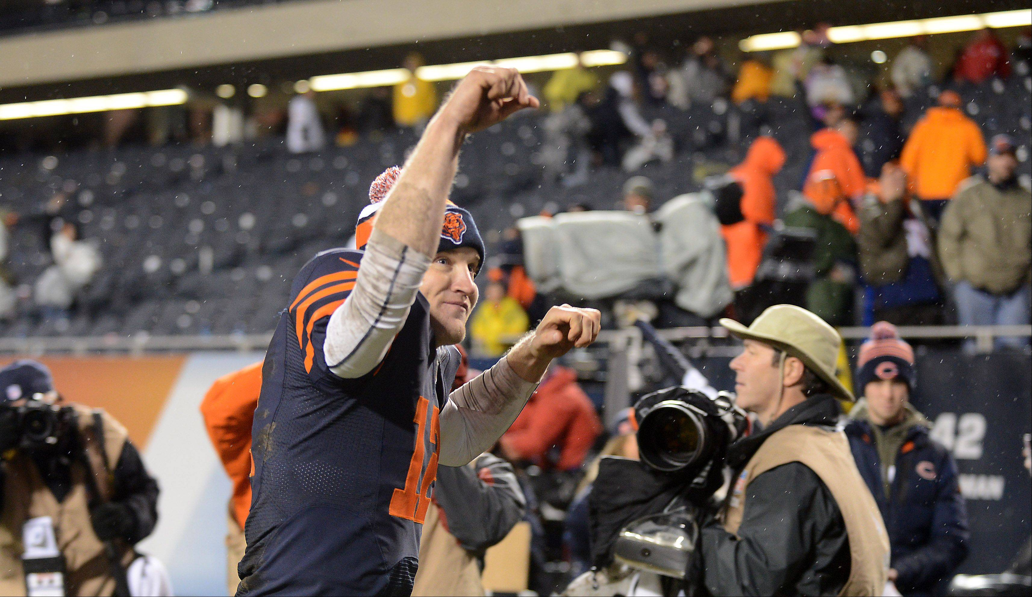 Chicago Bears quarterback Josh McCown (12) salutes the fans as he leaves the field following Sunday's game in Chicago.