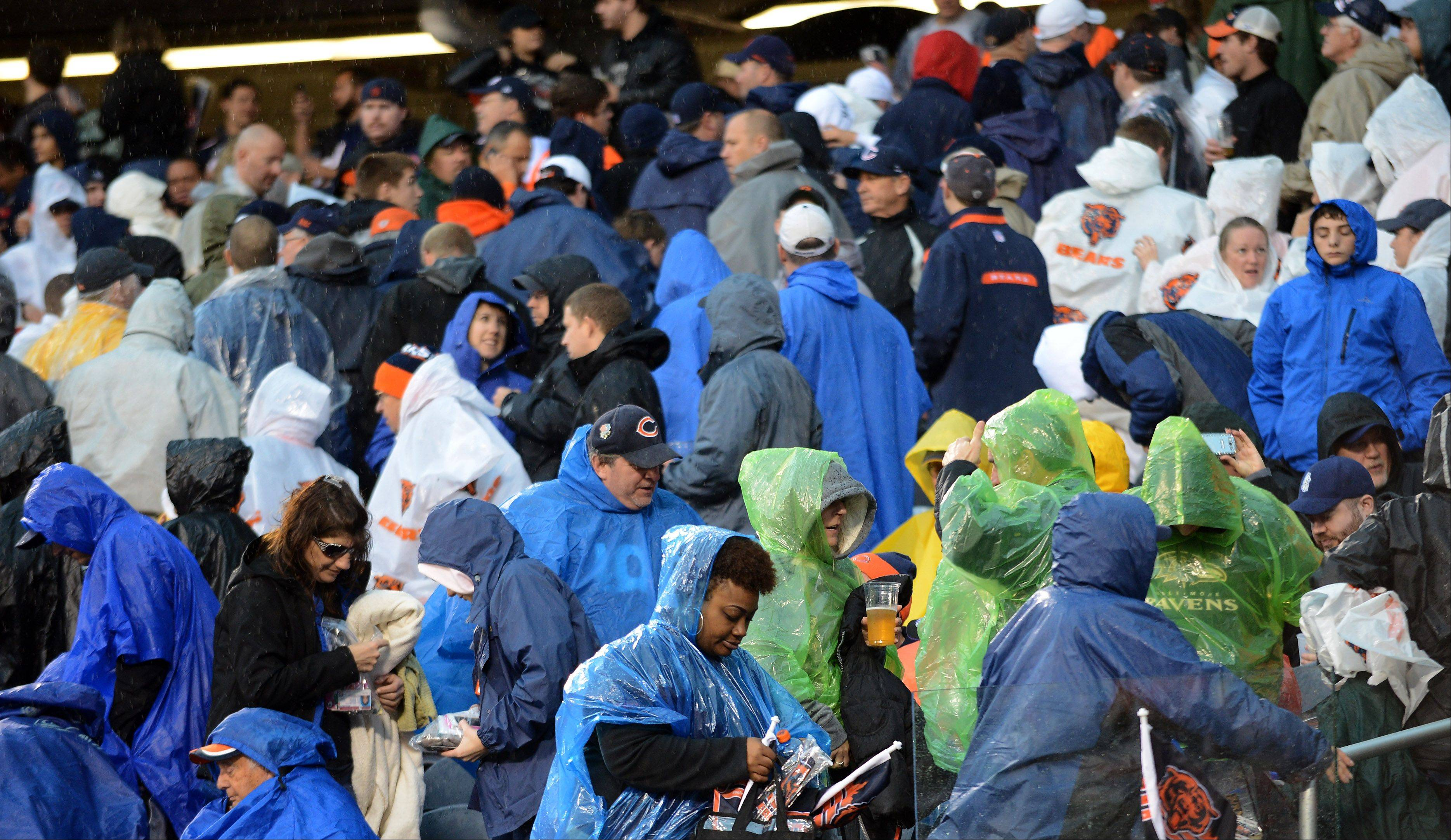 Fans head for the exits as the Bears game is delayed due to dangerous weather Sunday in Chicago.