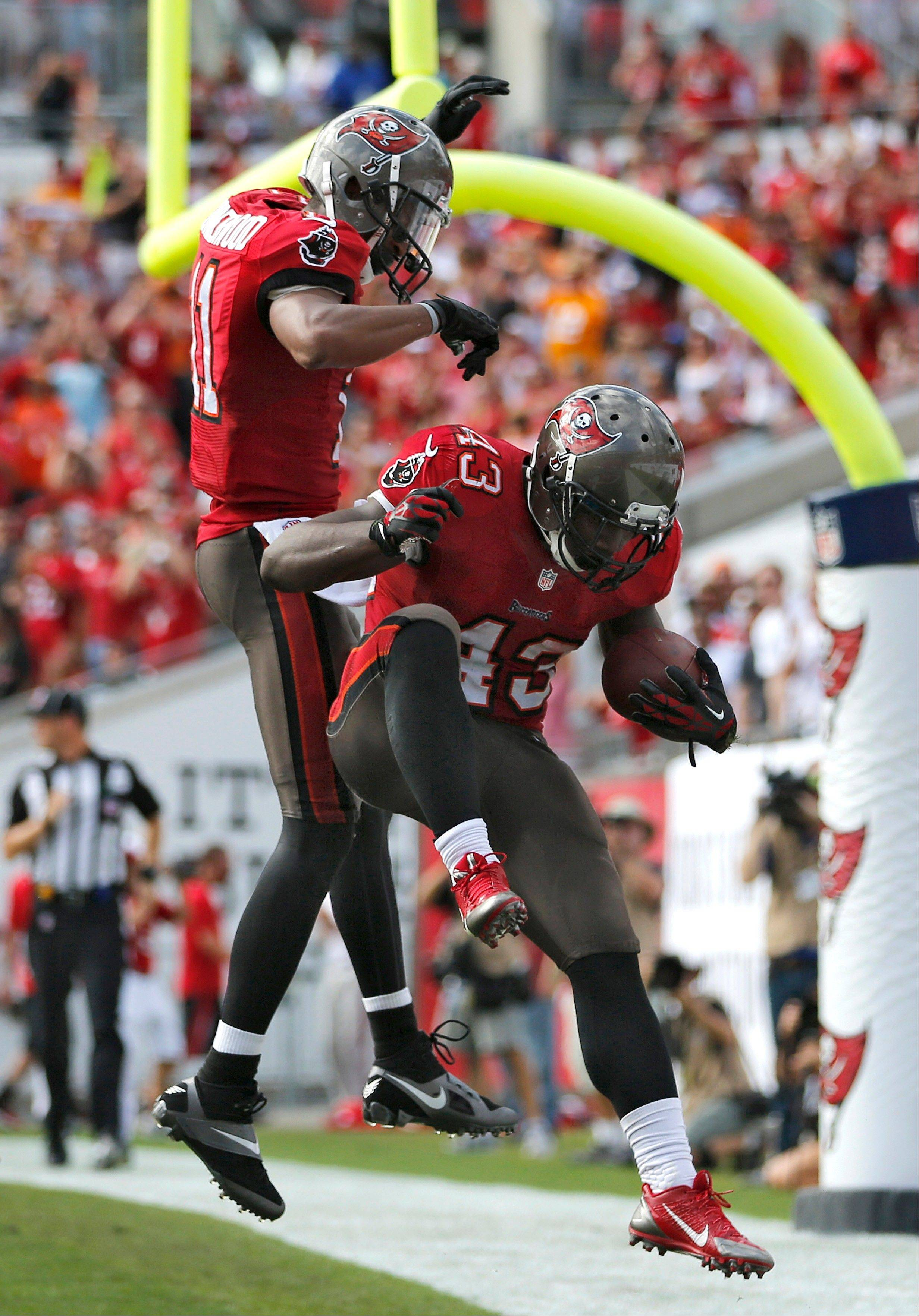 Tampa Bay Buccaneers running back Bobby Rainey (43) celebrates with wide receiver Tiquan Underwood (11) after scoring on a 43-yard touchdown run against the Atlanta Falcons during the second quarter of an NFL football game on Sunday, Nov. 17, 2013, in Tampa, Fla.