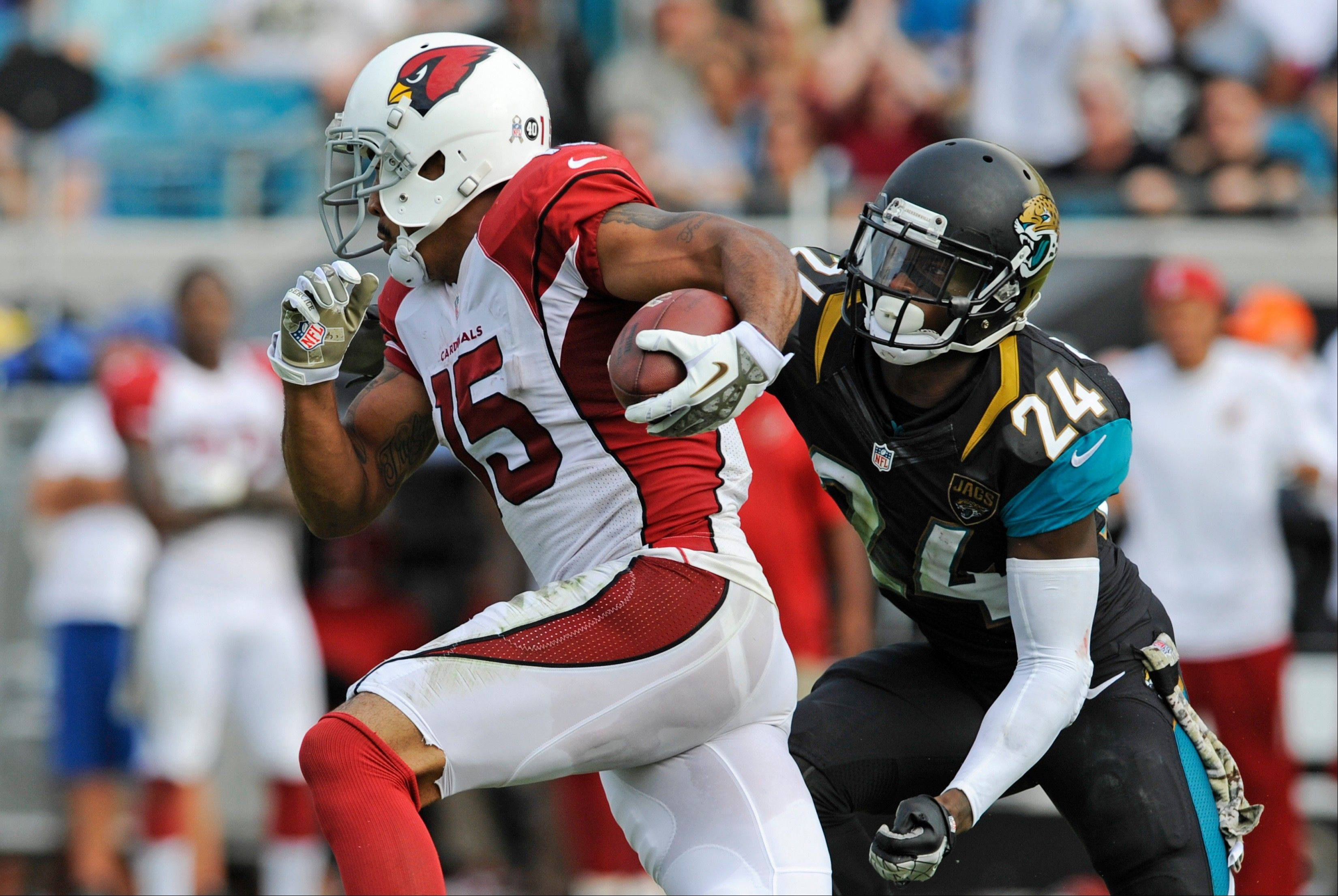 Arizona Cardinals wide receiver Michael Floyd (15) runs past Jacksonville Jaguars cornerback Will Blackmon (24) for a 91-yard touchdown in the second half of an NFL football game in Jacksonville, Fla., Sunday, Nov. 17, 2013.