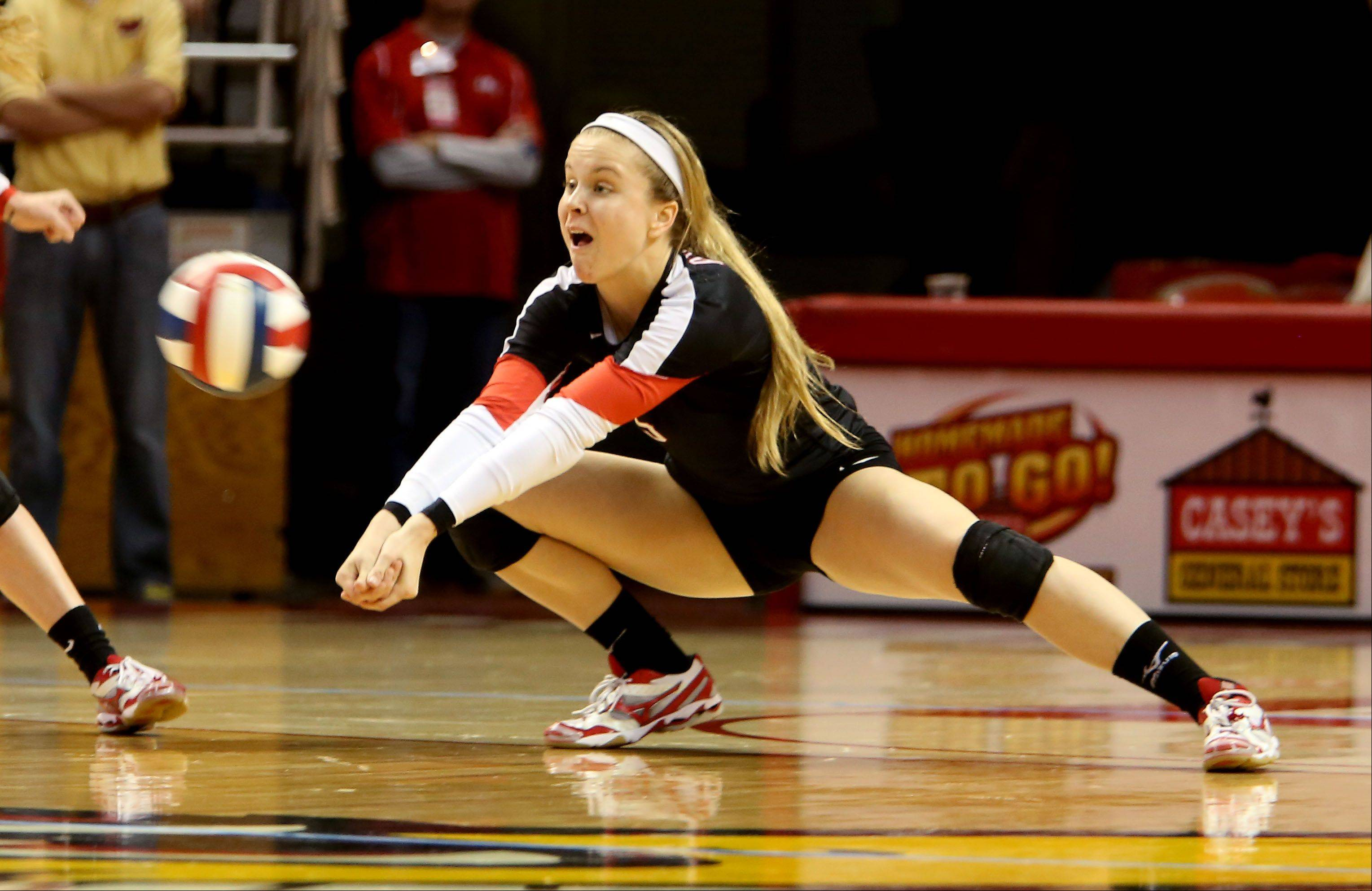 Tiffany Clark of Benet digs deep for a return against Mother McAuley in the Class 4A championship girls volleyball match on Saturday in Normal.