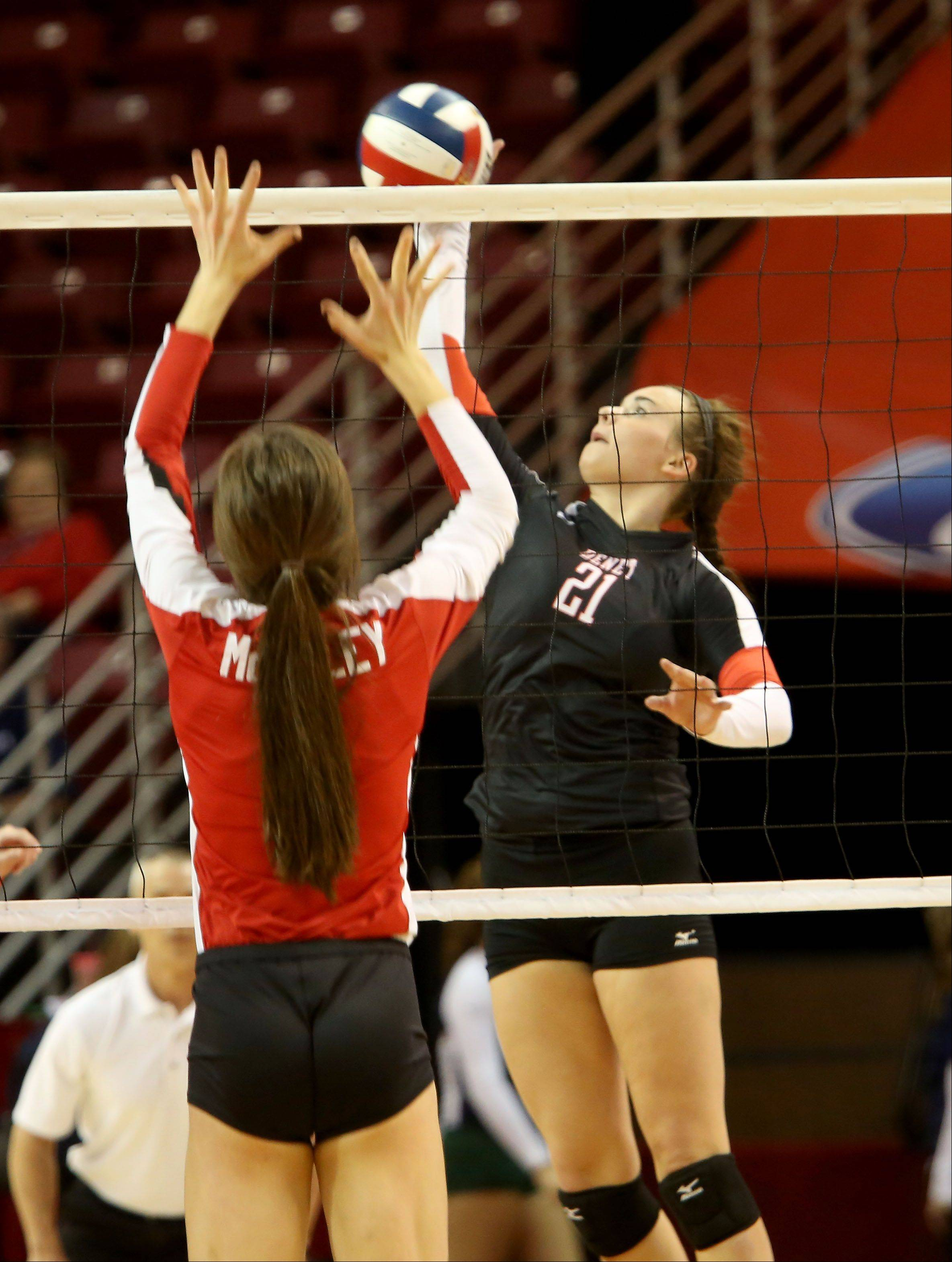 Ashley Hitchcock of Benet in action against Mother McAuley in the Class 4A championship girls volleyball match on Saturday in Normal.
