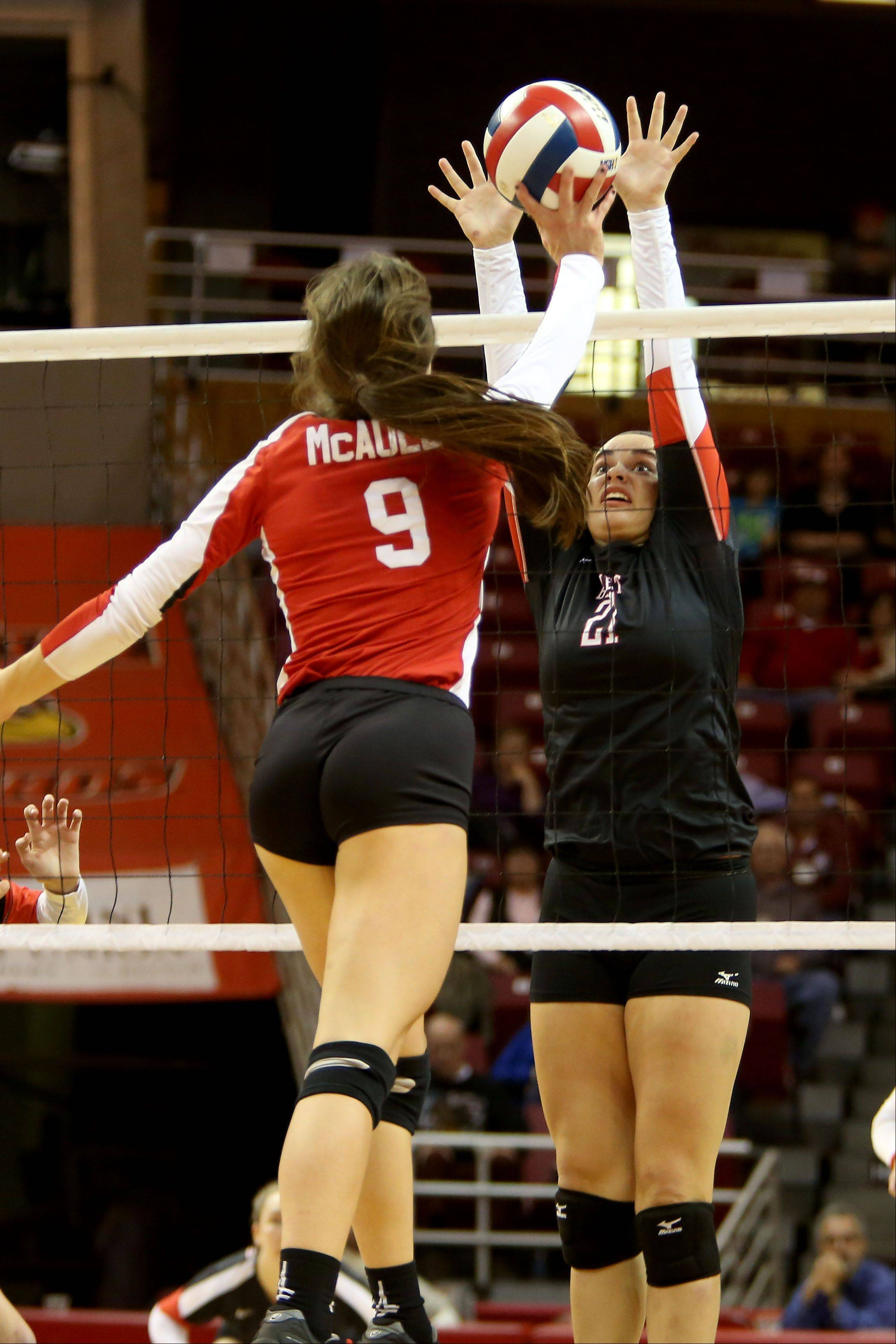 Ashley Hitchcock of Benet goes up to block a shot by Maggie Scanlon of Mother McAuley in the Class 4A championship girls volleyball match on Saturday in Normal.