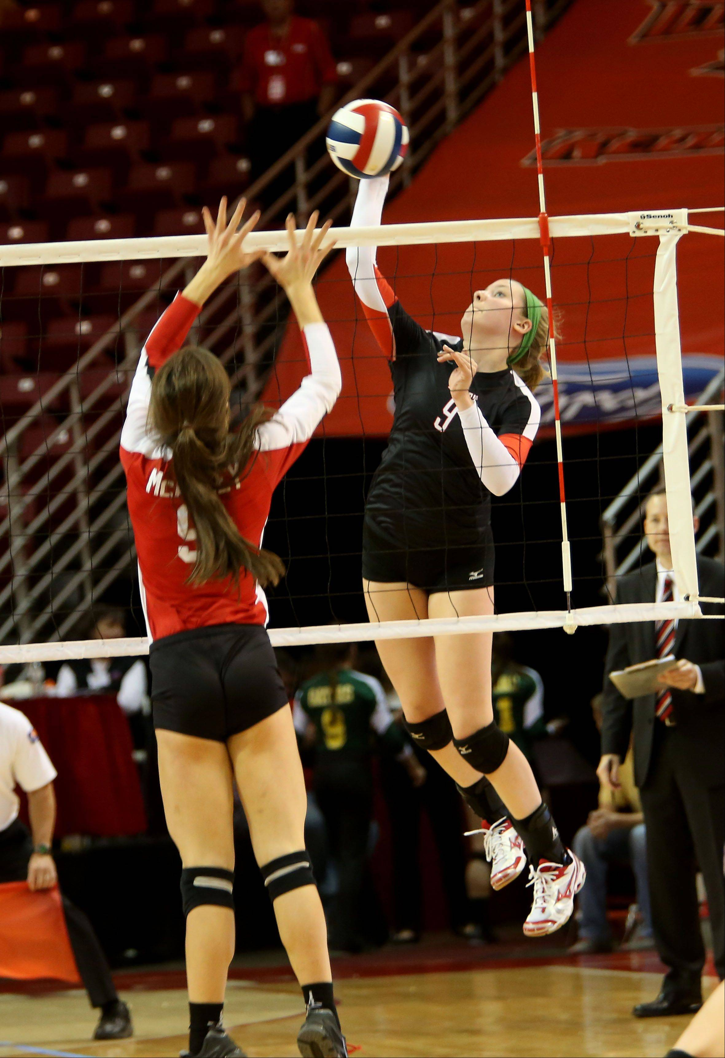 Dana Griffin of Benet goes up to spike the ball against Mother McAuley in the Class 4A championship girls volleyball match on Saturday in Normal.