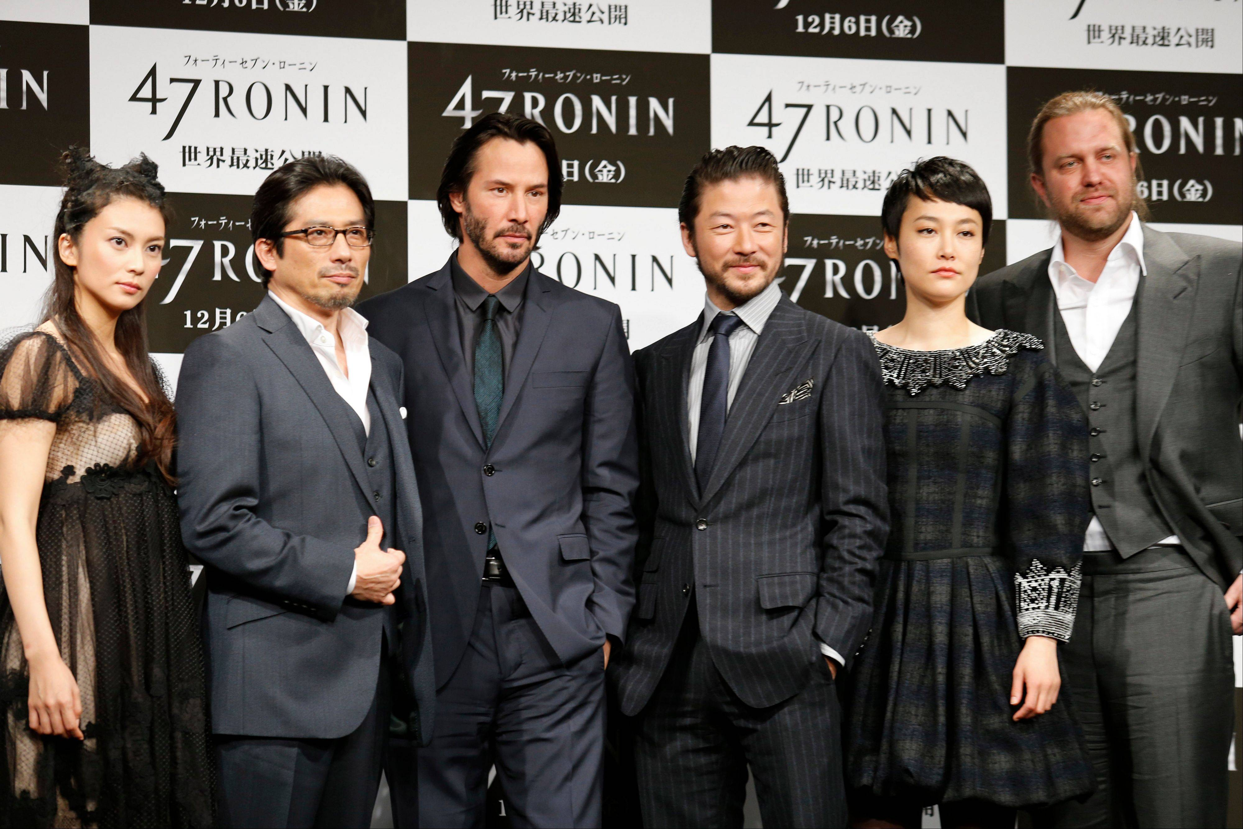 "Actors and actresses, from left, Ko Shibasaki, Hiroyuki Sanada, Keanu Reeves, Tadanobu Asano, Rinko Kikuch and director Carl Rinsch pose for photographers during a press conference to promote the 3-D film ""47 Ronin"" in Tokyo, Japan, Monday."