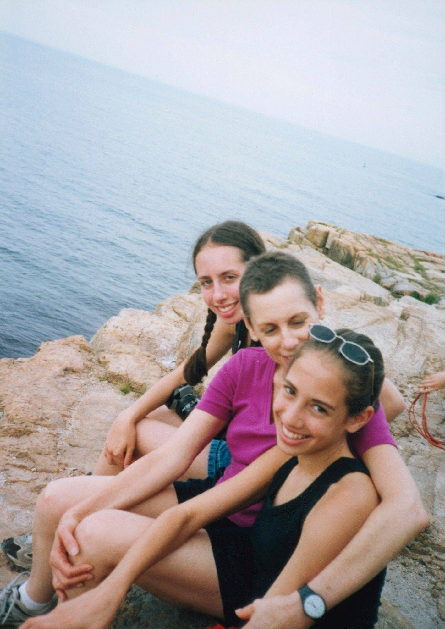 While undergoing treatment for cancer in 2002, Marsha Silver shares a moment with her daughters Daniela, foreground, and Maya.