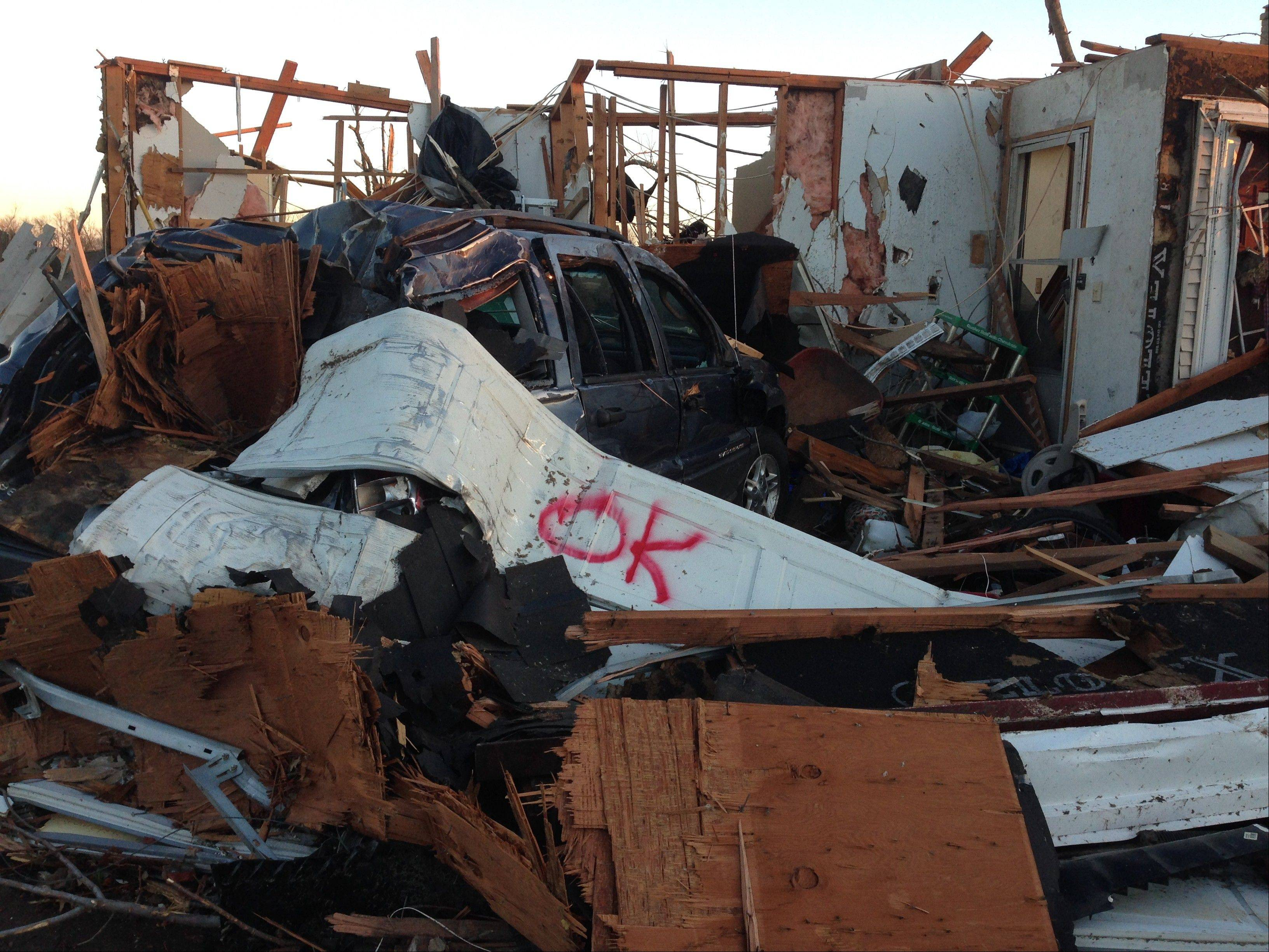 Sunday's tornado lifted Bob and Marianne Riopell's garage from around their Jeep Grand Cherokee in Washington, Ill.
