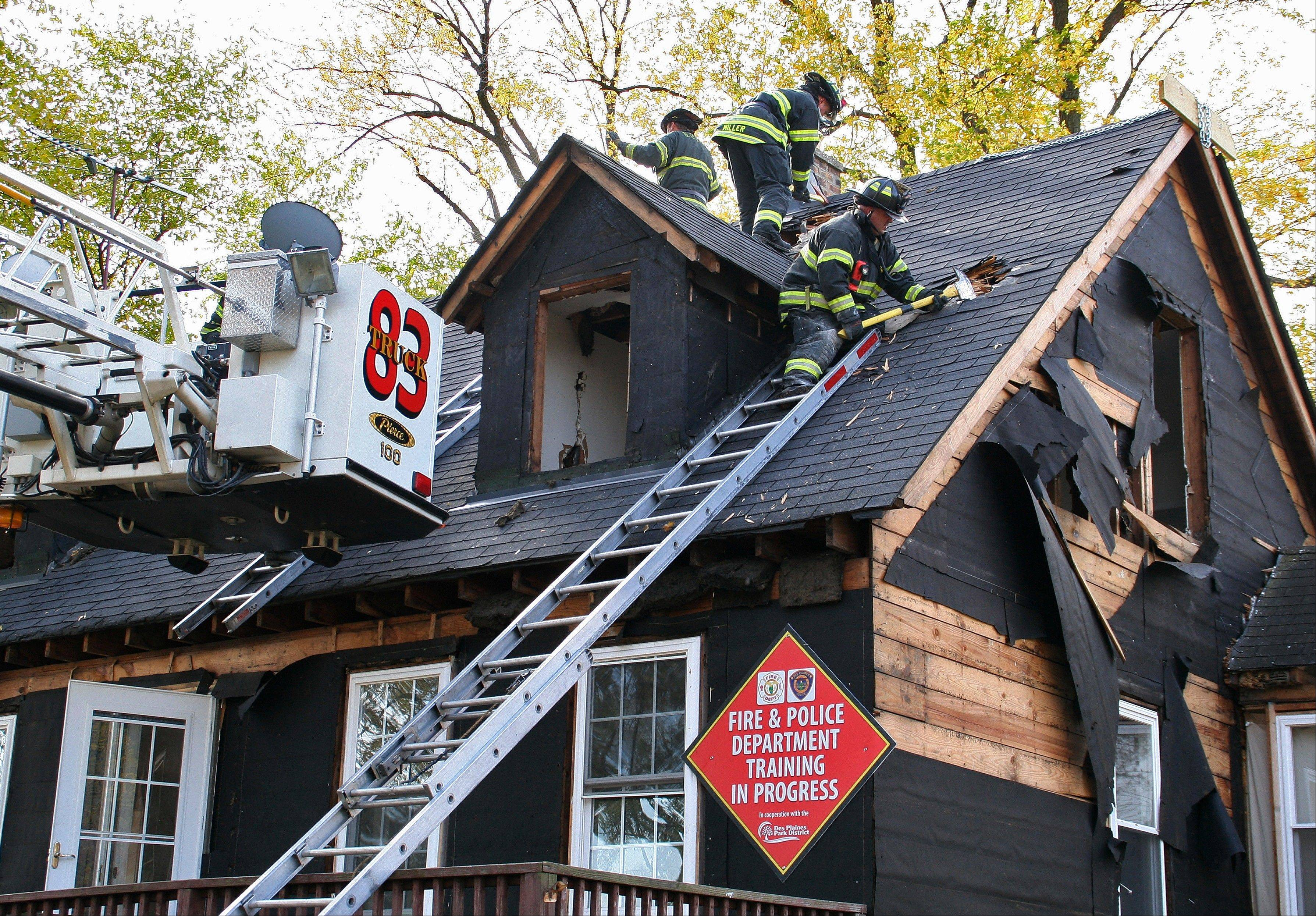 "The Des Plaines Fire Department put holes in the roof to ventilate the ""fire"" inside the White Street House at Arndt Park."