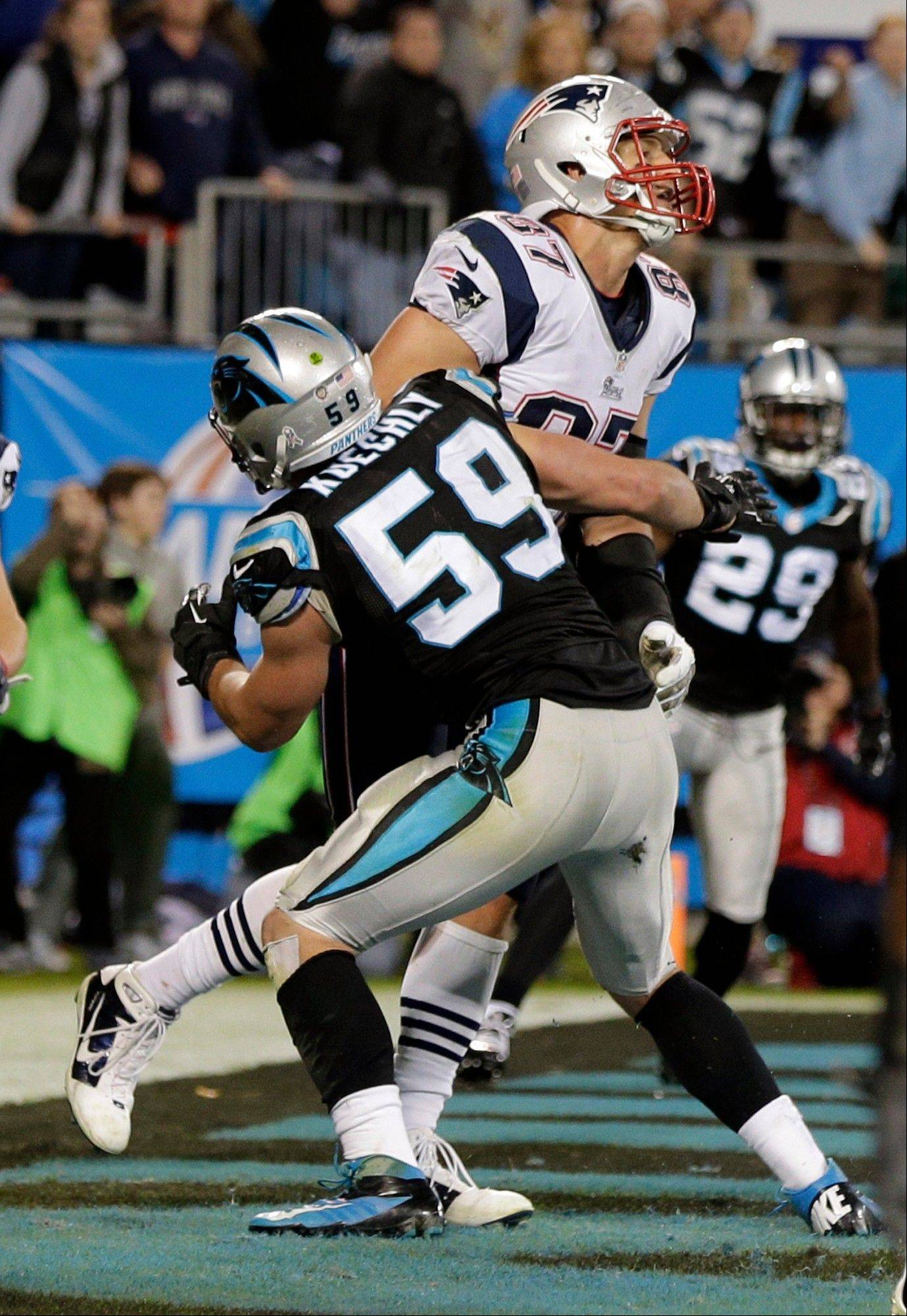 The Panthers� Luke Kuechly blocks the Patriots� Rob Gronkowski on the final play of the game Monday in Charlotte, N.C. A flag was thrown, but officials later decided no penalty had occurred.