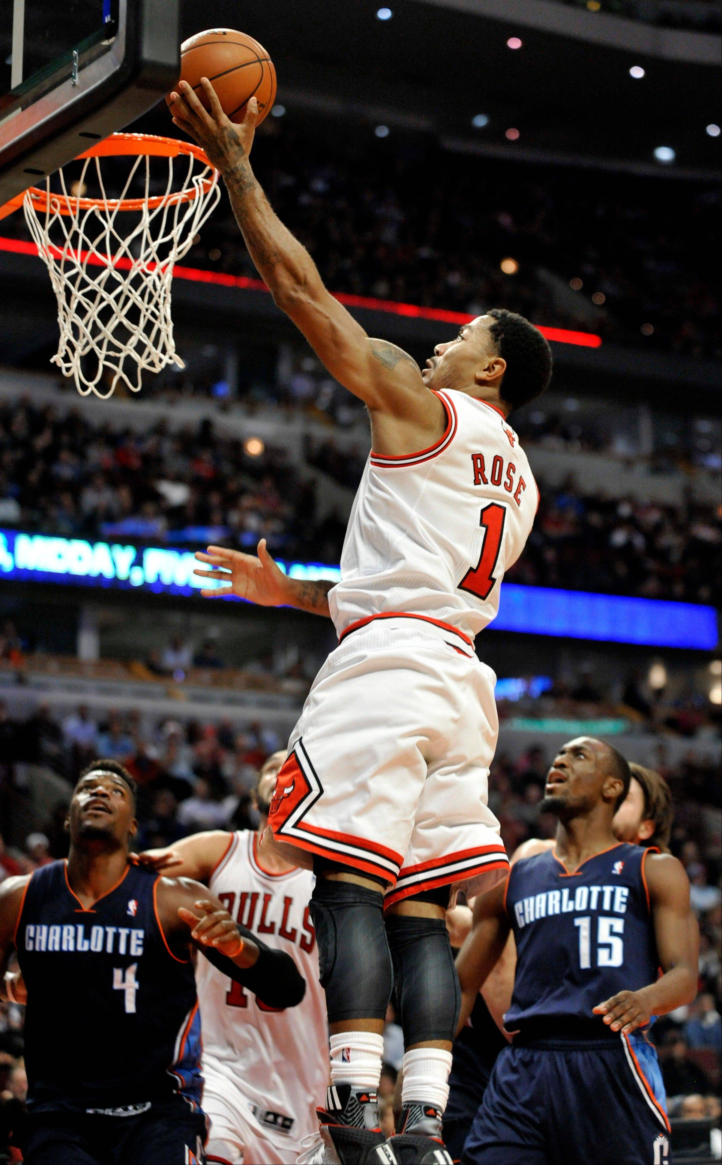 The Bulls' Derrick Rose goes up for a shot during the fourth quarter Monday night.