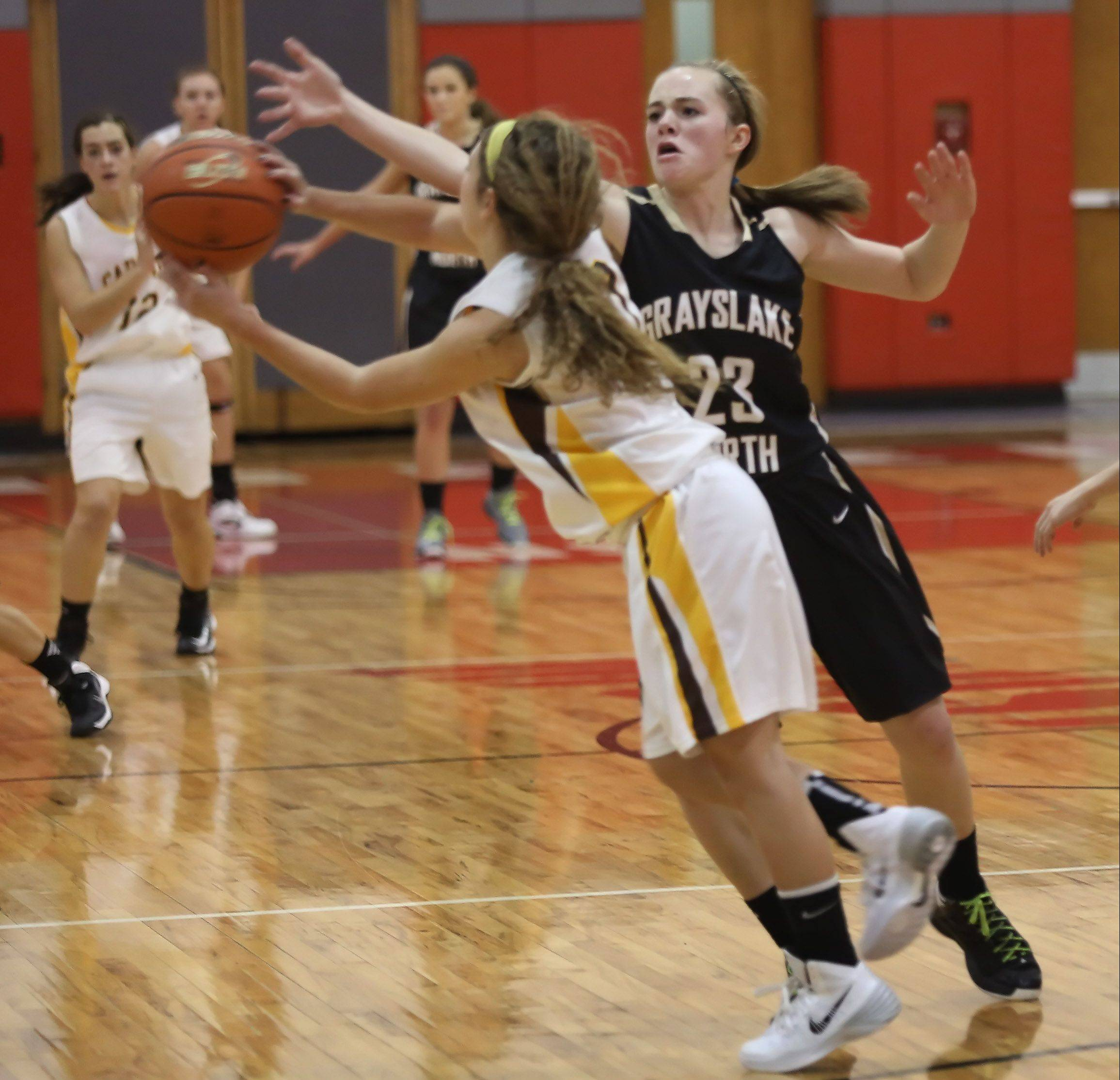 Grayslake North guard Sydney Lovitsch tries to block the pass by Carmel guard Sam Melillo during Monday�s in the Mundelein tournament.