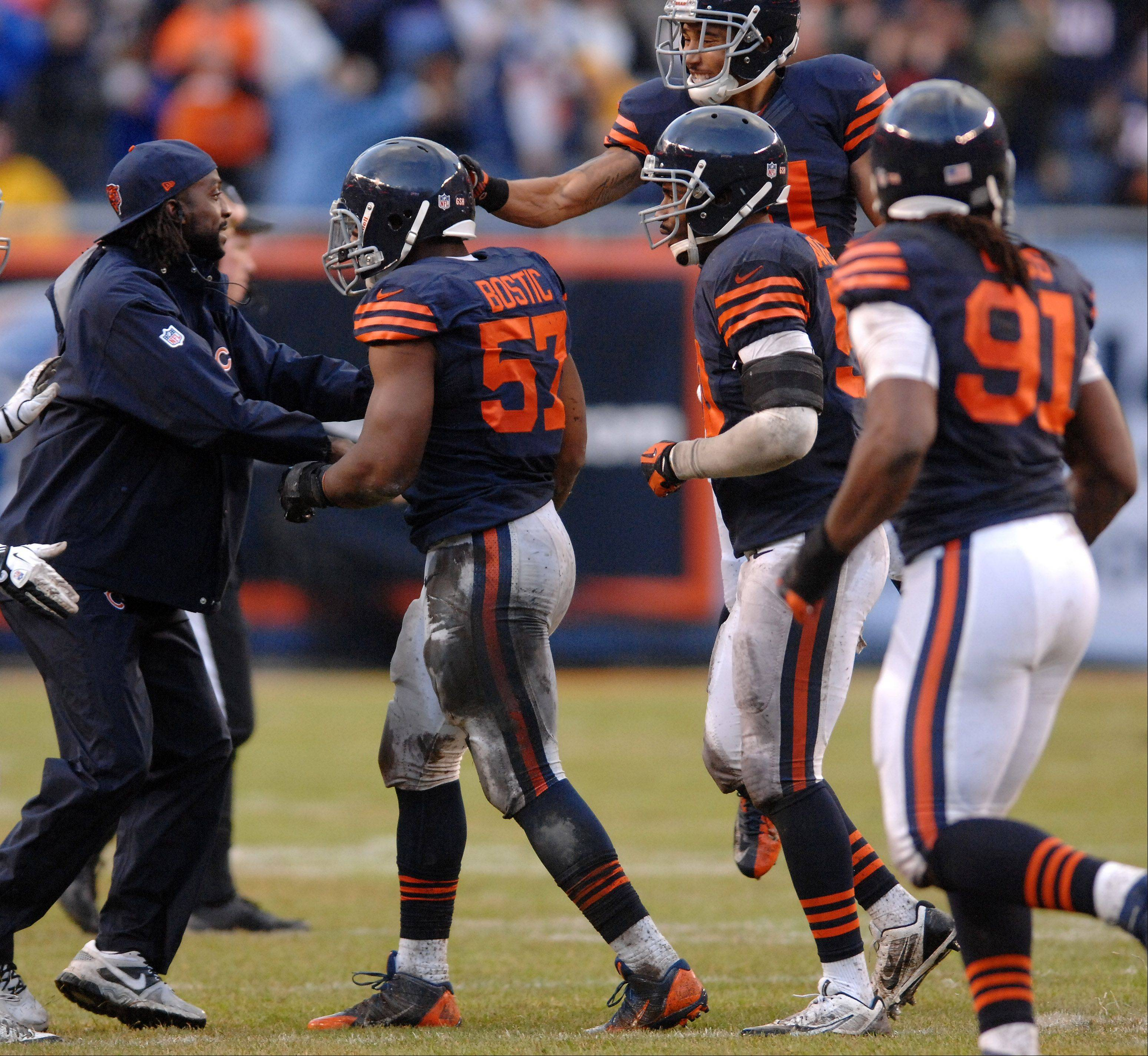 Rick West/rwest@dailyherald.com Injured cornerback Charles Tillman greets and congratulates Bears linebacker Jon Bostic after his interception during Sunday's victory over Baltimore.