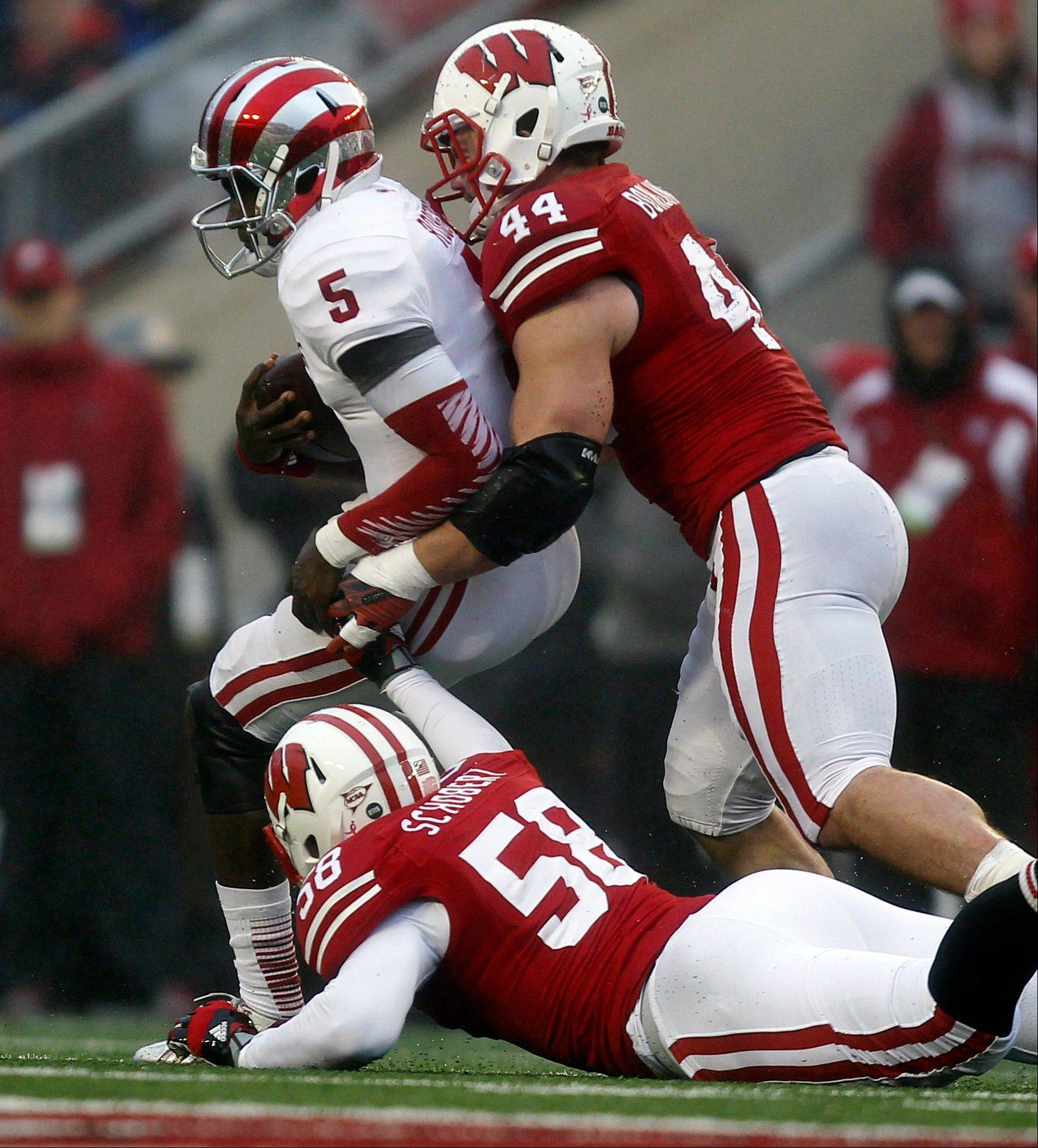 Indiana quarterback Tre Roberson is sacked by Wisconsin's Chris Borland (44) and Joe Schobert during the first half of Saturday's game in Madison, Wis. The Badgers routed the Hoosiers 51-3.