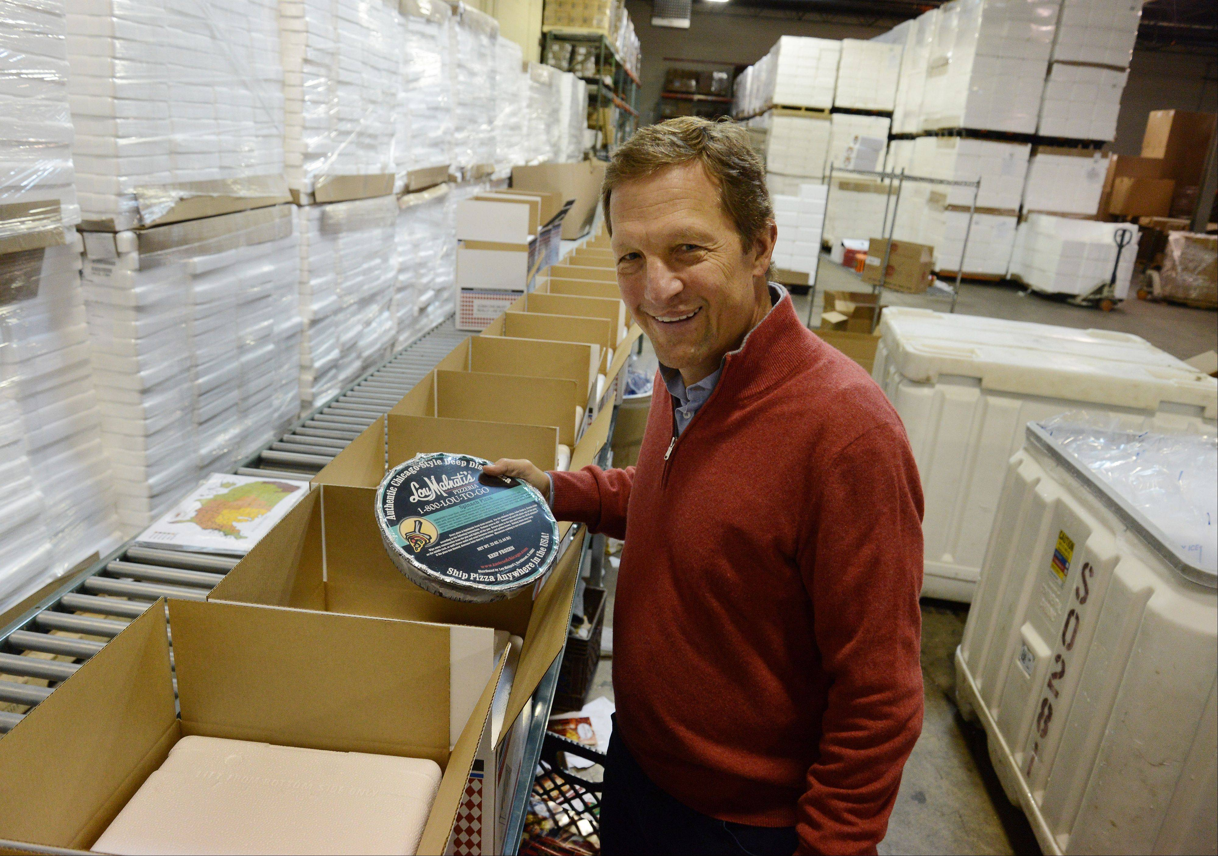 Marc Malnati of Lou Malnati's Pizza, with some Lou to Go ready for shipping.