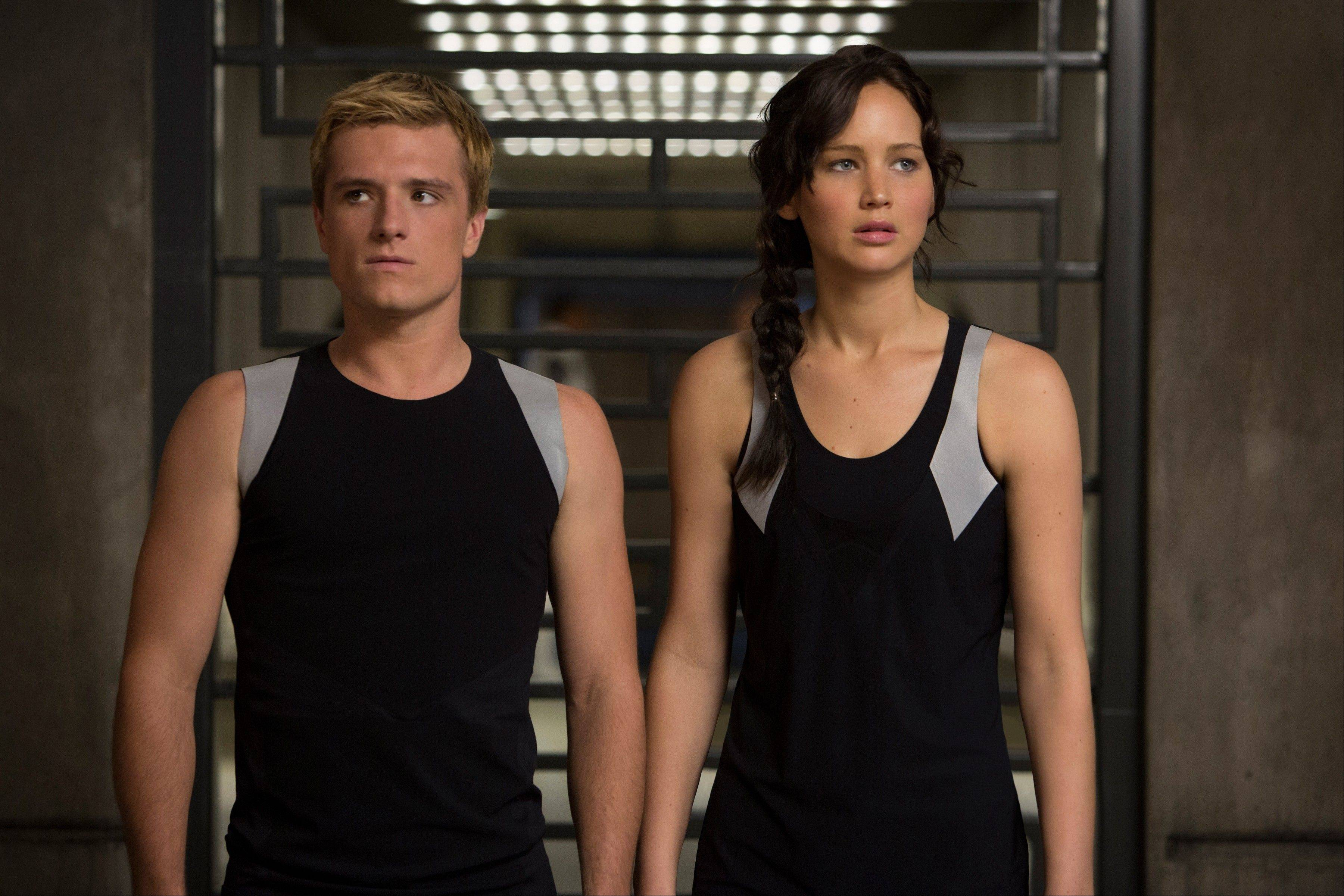 "Katniss Everdeen (Jennifer Lawrence) and Peeta (Josh Hutcherson) prepare for another round of killing as a televised sport in ""The Hunger Games: Catching Fire."""