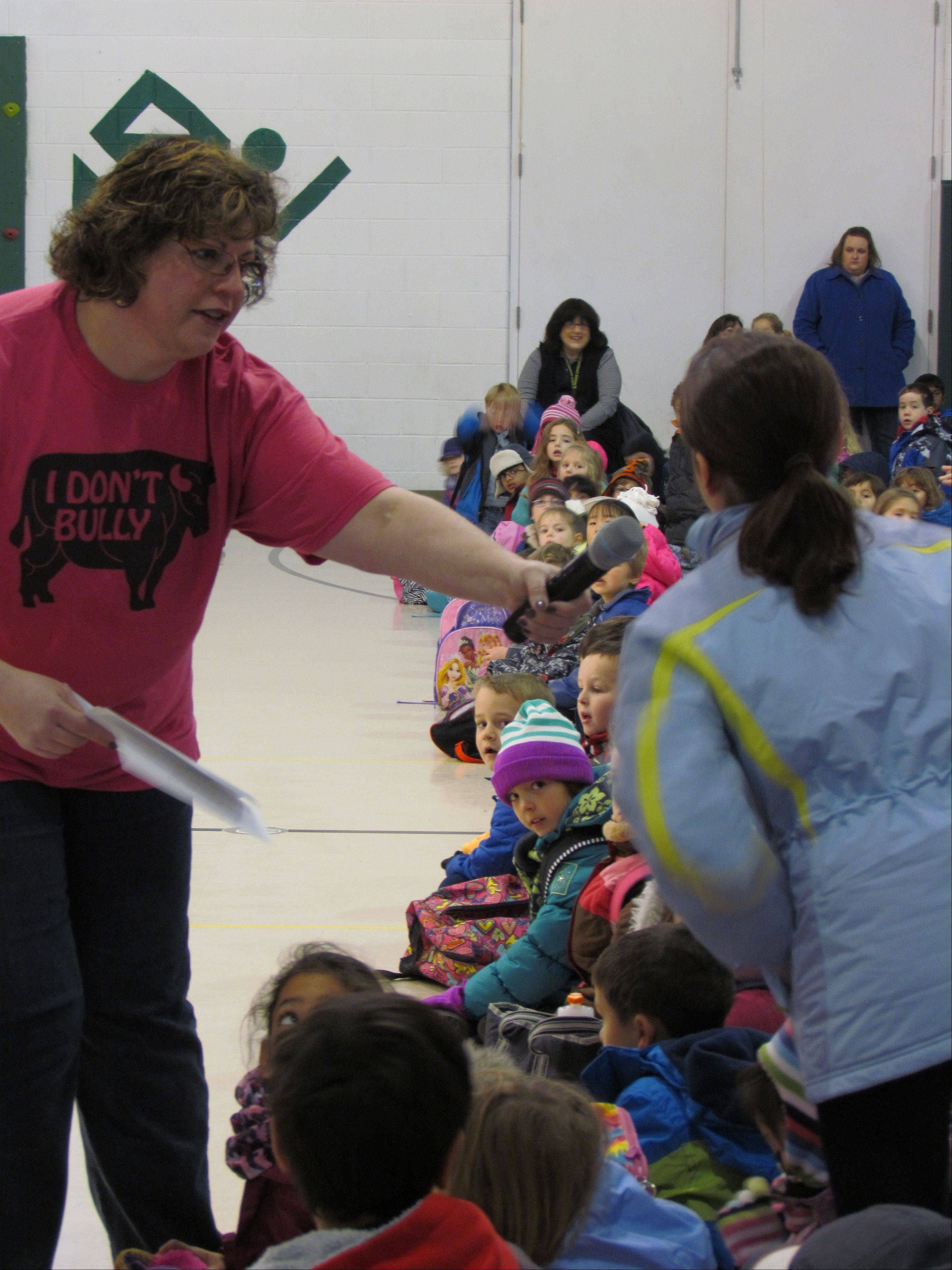 Social worker Caryn Meyer at Prairie Crossing Charter School in Grayslake addresses children in Monday's opening ceremony for Bully Awareness Week there.