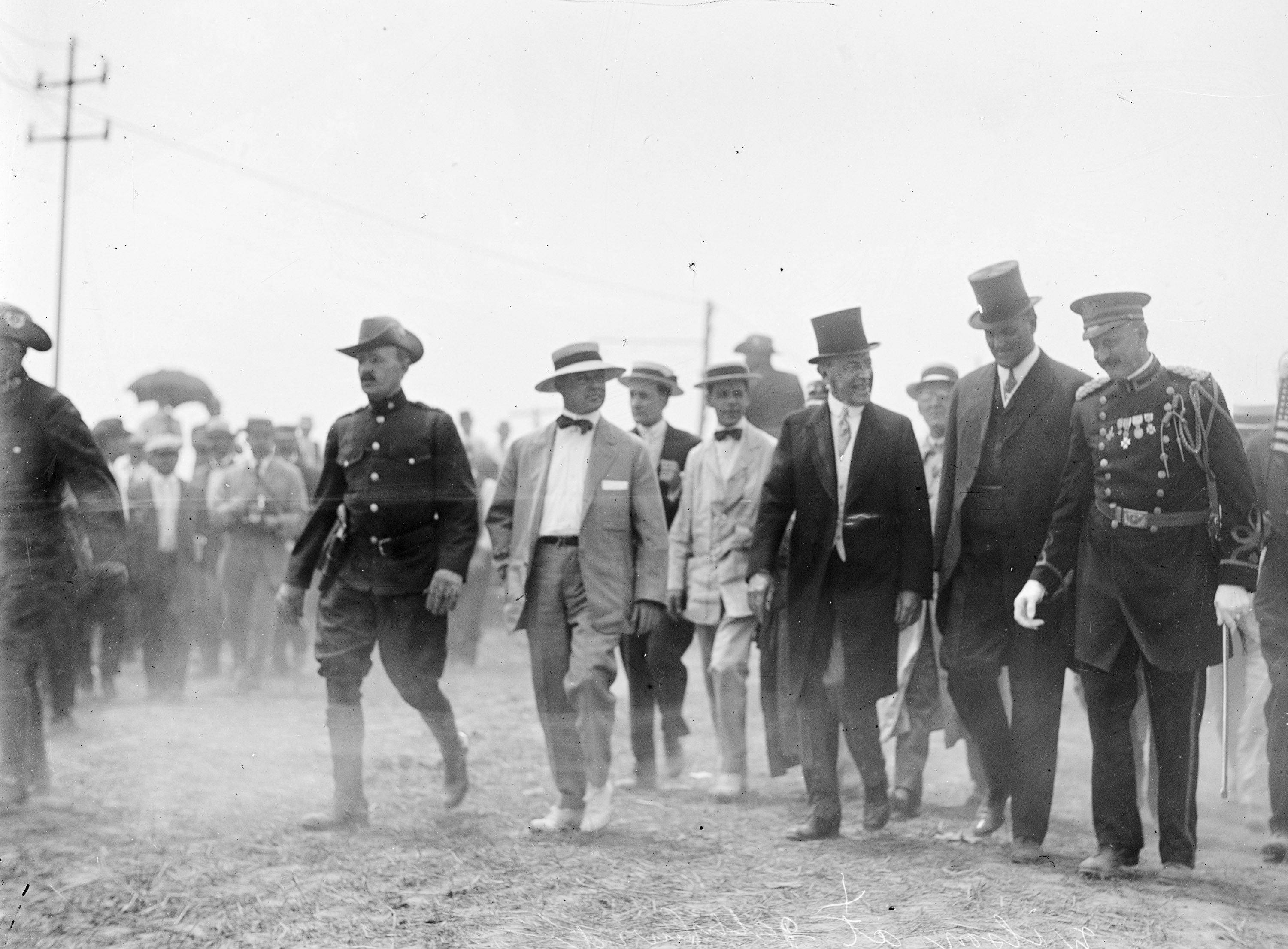 "In this July 1913 photo made available by the Library of Congress, President Woodrow Wilson, third from right, attends a commemoration for the 50th anniversary of the Battle of Gettysburg. After Abraham Lincoln, the first major presidential address at Gettysburg was given at this event by Wilson, who privately ranked Lincoln's speech as ""very, very high,"" and offered a vague tribute to national unity that disappointed admirers of a man whose speechmaking had enabled his quick rise from Princeton president to the White House. According to a new biography by A. Scott Berg, Wilson was a reluctant guest of honor. He initially turned down an invitation and gave in only after being warned that the Virginia-born president would be perceived as hostile to a gathering attended by veterans from both sides."