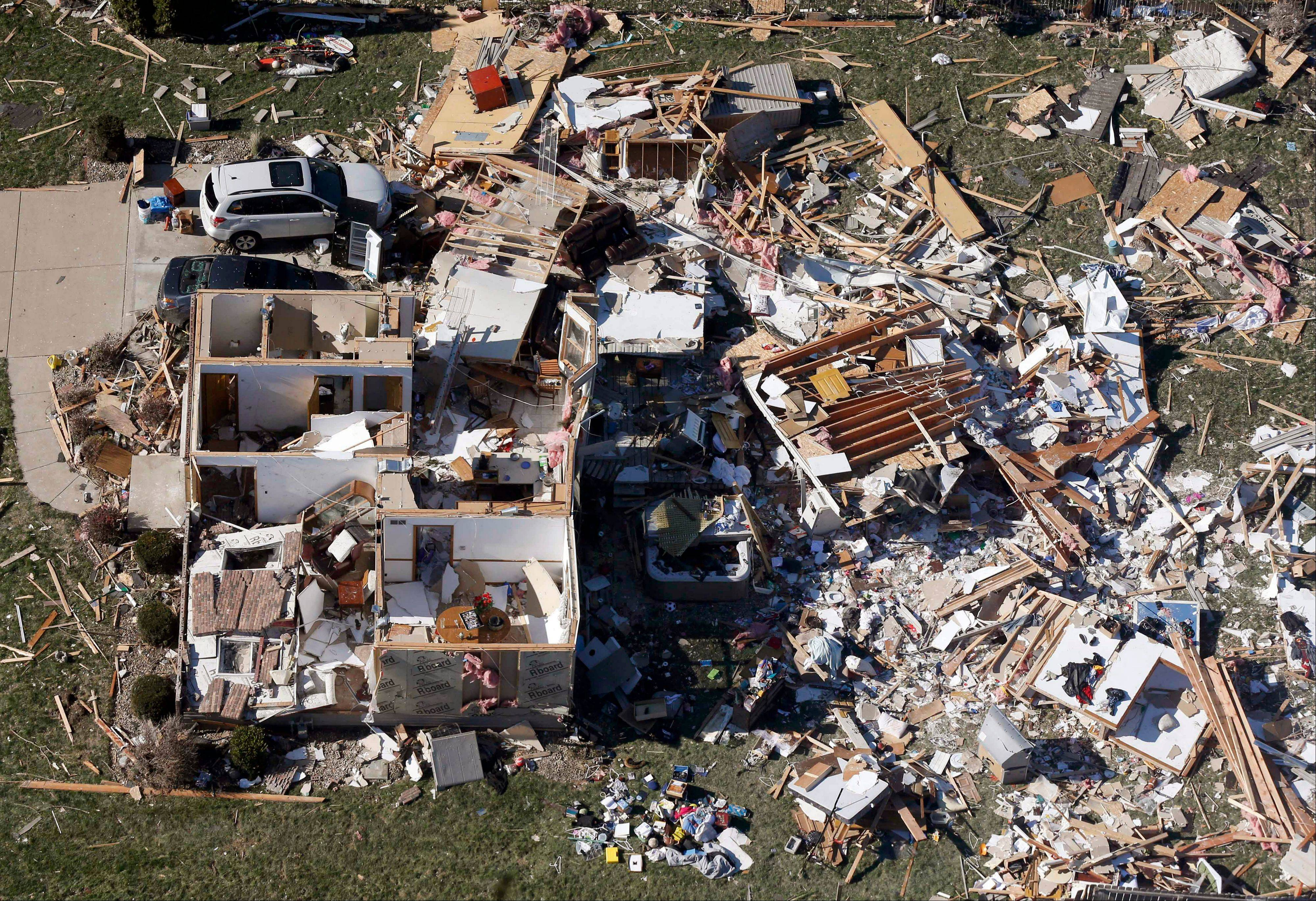 This aerial view on Monday, Nov. 18, 2013, shows a home that was destroyed by a tornado that hit the western Illinois town of Washington on Sunday. It was one of the worst-hit areas after intense storms and tornadoes swept through Illinois. The National Weather Service says the tornado that hit Washington had a preliminary rating of EF-4, meaning wind speeds of 170 mph to 190 mph.
