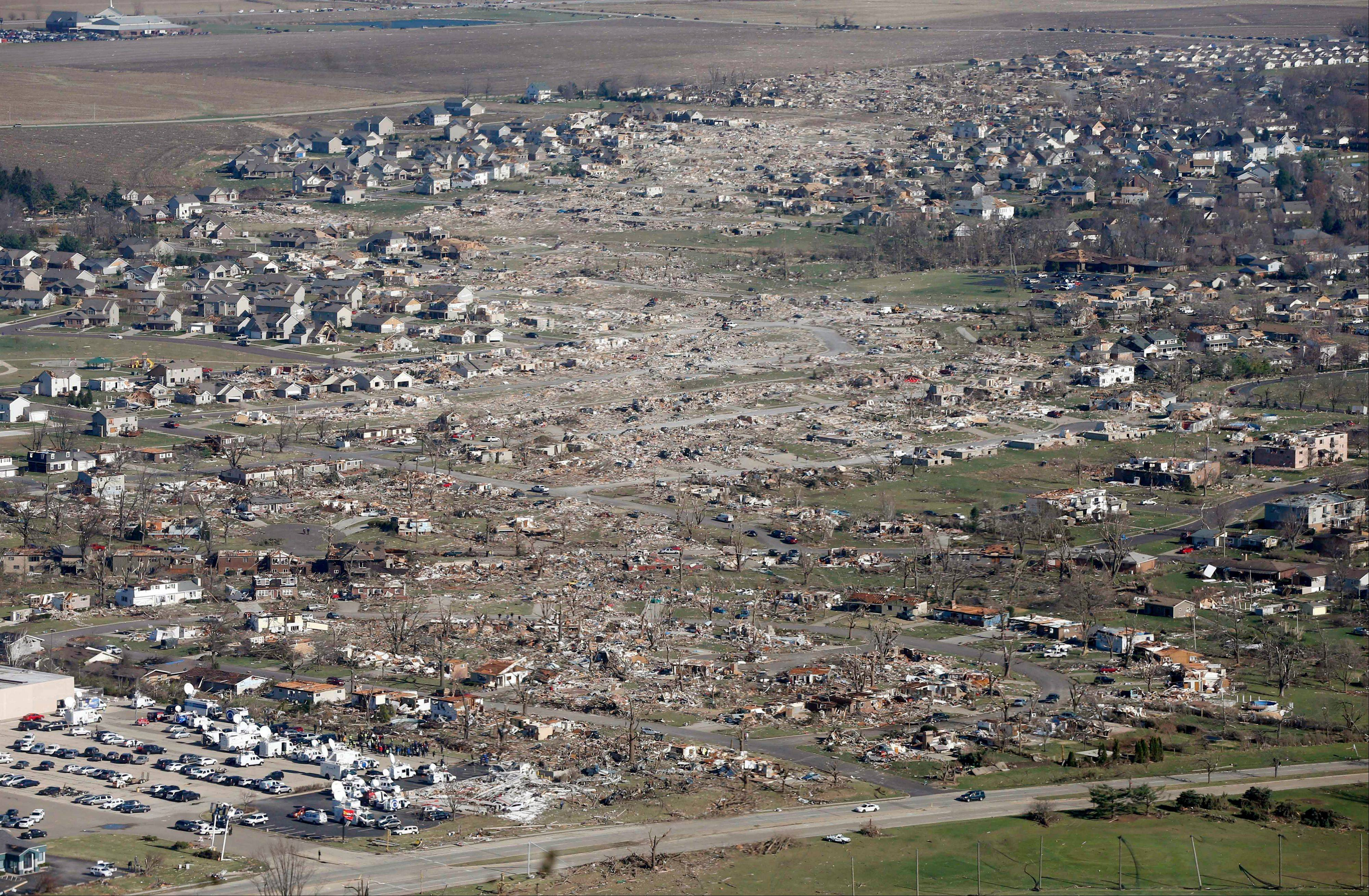 This aerial view on Monday, Nov. 18, 2013, shows the path of a tornado that hit the western Illinois town of Washington on Sunday. It was one of the worst-hit areas after intense storms and tornadoes swept through Illinois. The National Weather Service says the tornado that hit Washington had a preliminary rating of EF-4, meaning wind speeds of 170 mph to 190 mph.