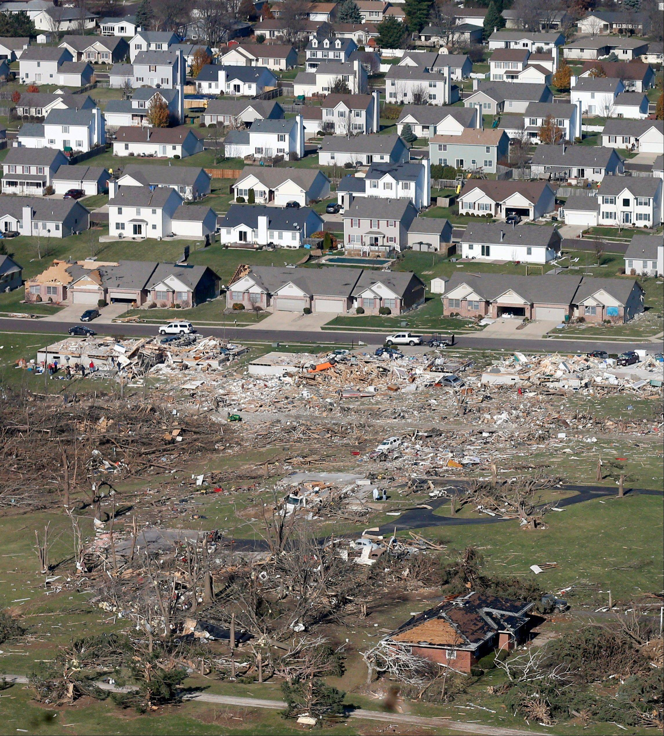This aerial view on Monday, Nov. 18, 2013, shows untouched homes and homes destroyed by a tornado that hit the western Illinois town of Washington on Sunday. It was one of the worst-hit areas after intense storms and tornadoes swept through Illinois. The National Weather Service says the tornado that hit Washington had a preliminary rating of EF-4, meaning wind speeds of 170 mph to 190 mph.