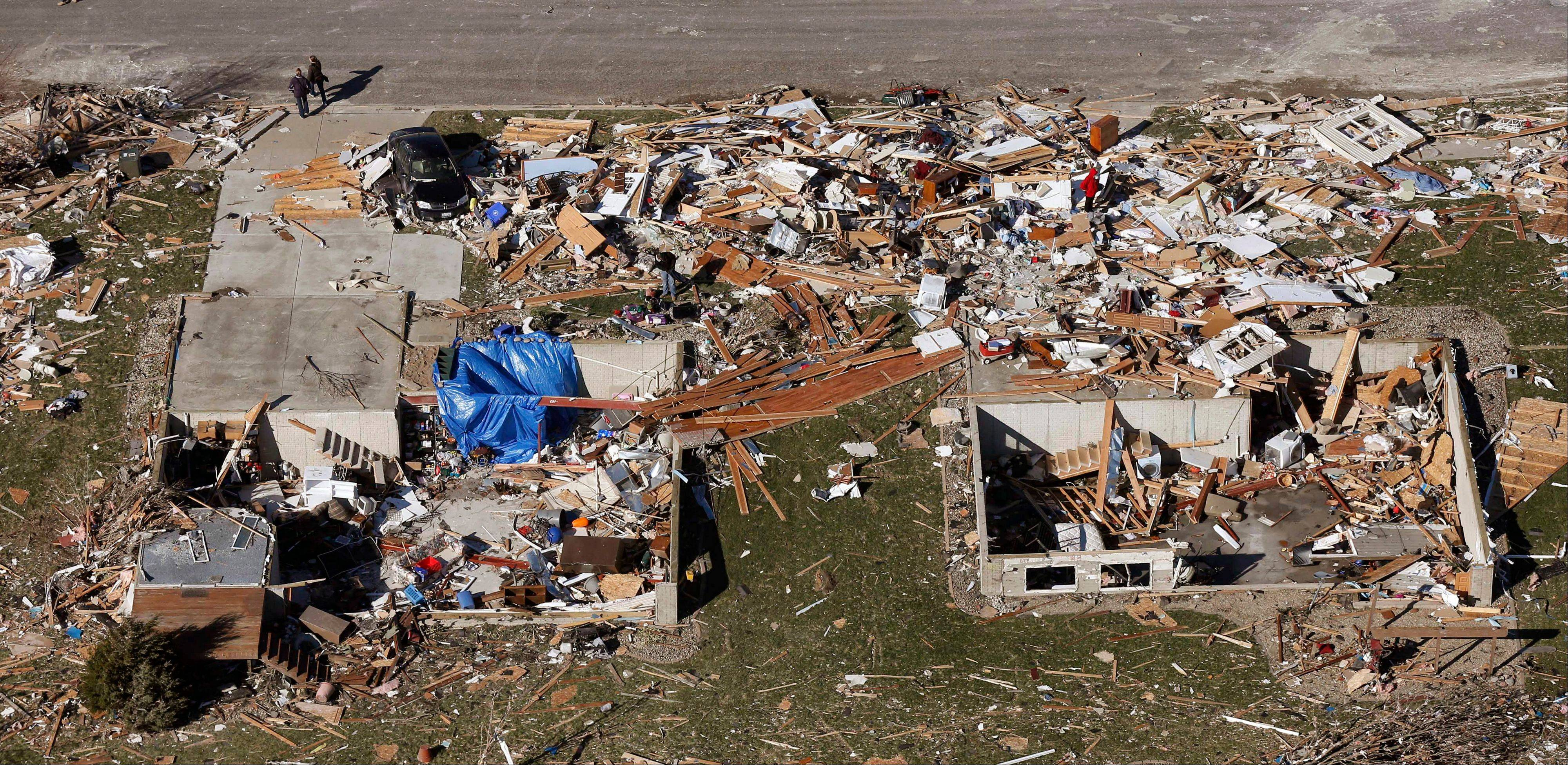 This aerial view on Monday, Nov. 18, 2013, shows homes that were destroyed by a tornado that hit the western Illinois town of Washington on Sunday. It was one of the worst-hit areas after intense storms and tornadoes swept through Illinois. The National Weather Service says the tornado that hit Washington had a preliminary rating of EF-4, meaning wind speeds of 170 mph to 190 mph.
