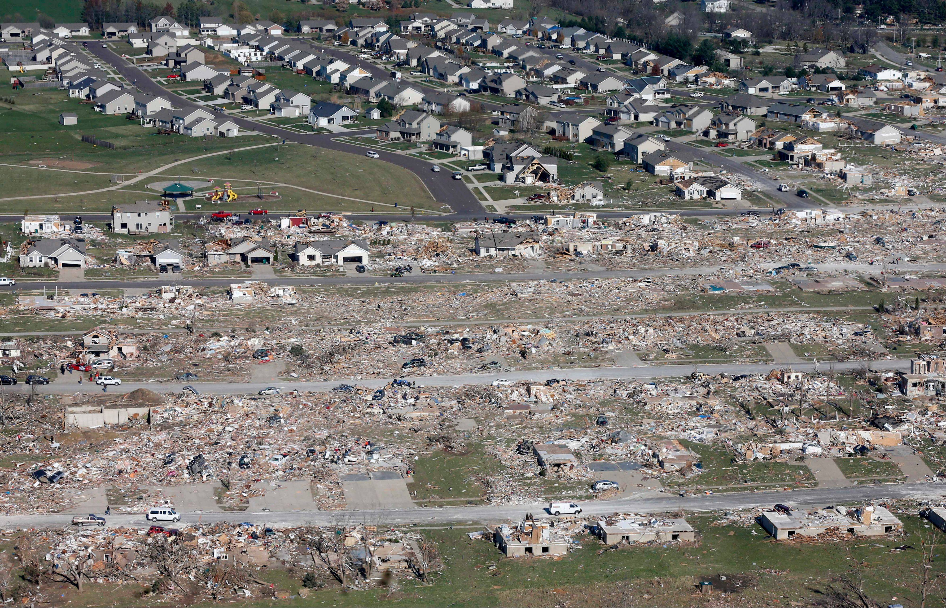 This aerial view on Monday, Nov. 18, 2013, shows homes that were untouched and destroyed by a tornado that hit the western Illinois town of Washington on Sunday. It was one of the worst-hit areas after intense storms and tornadoes swept through Illinois. The National Weather Service says the tornado that hit Washington had a preliminary rating of EF-4, meaning wind speeds of 170 mph to 190 mph.
