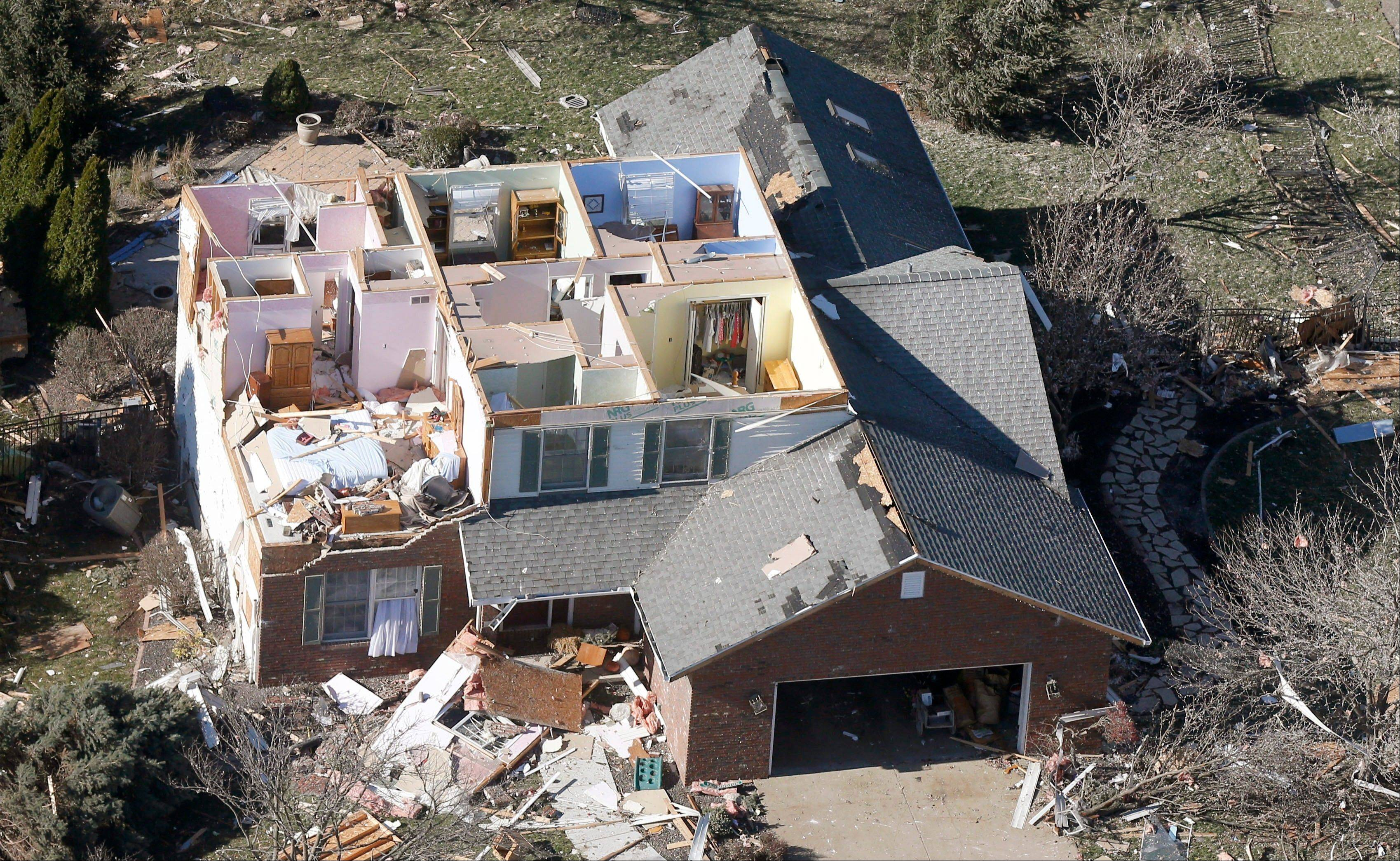 This aerial view on Monday, Nov. 18, 2013, shows a home that was damaged by a tornado that hit the western Illinois town of Washington on Sunday. It was one of the worst-hit areas after intense storms and tornadoes swept through Illinois. The National Weather Service says the tornado that hit Washington had a preliminary rating of EF-4, meaning wind speeds of 170 mph to 190 mph.