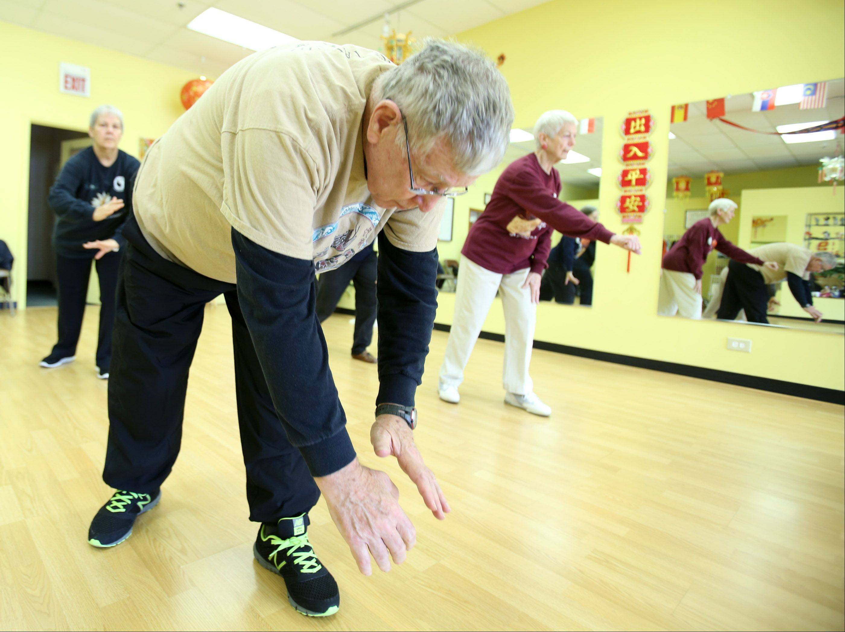 Tai Chi isn't just for women, Bud Mitchell of Arlington Heights and the other men in this Tai Chi class show.