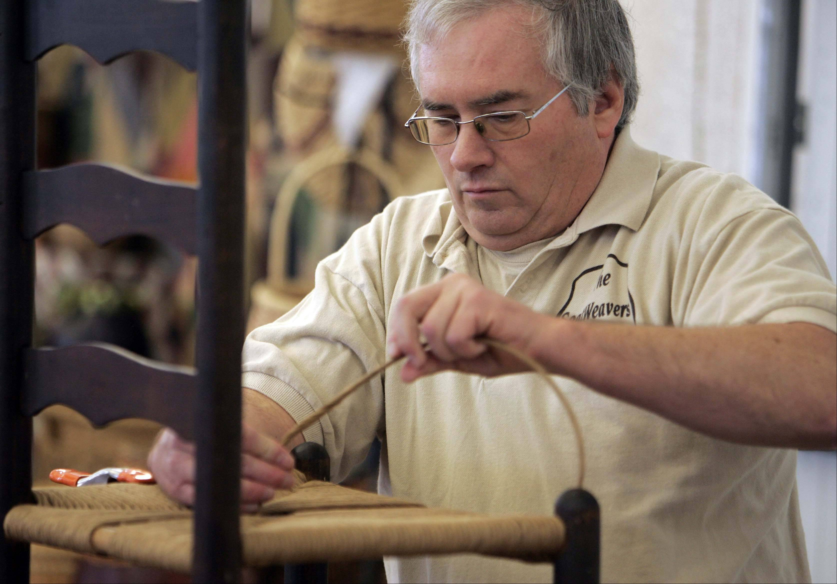 Bill Morse of Seat Weavers from Elgin works on repairing a chair during last year's Christmas on the Fox. This year's show will feature 70 artisans and crafters.