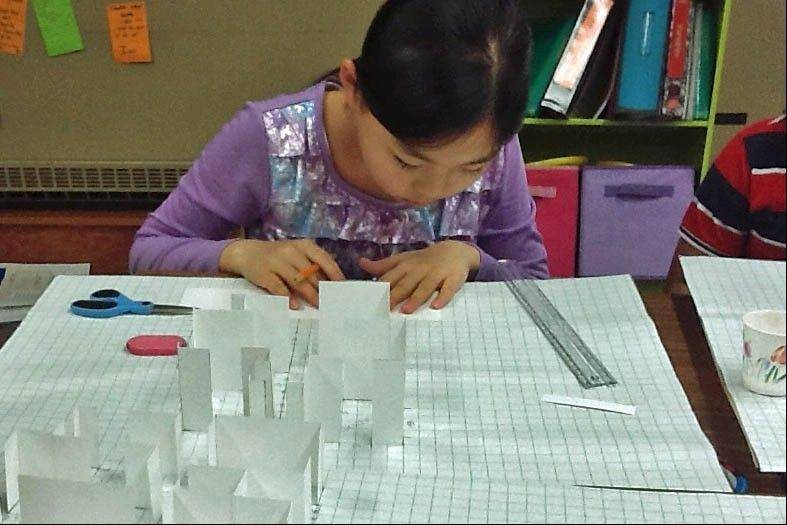Renee Jeng, 10, a fifth-grader at Schiesher Elementary School in Lisle, works on designing a house as inspired by Frank Lloyd Wright during the Build it Wright project.
