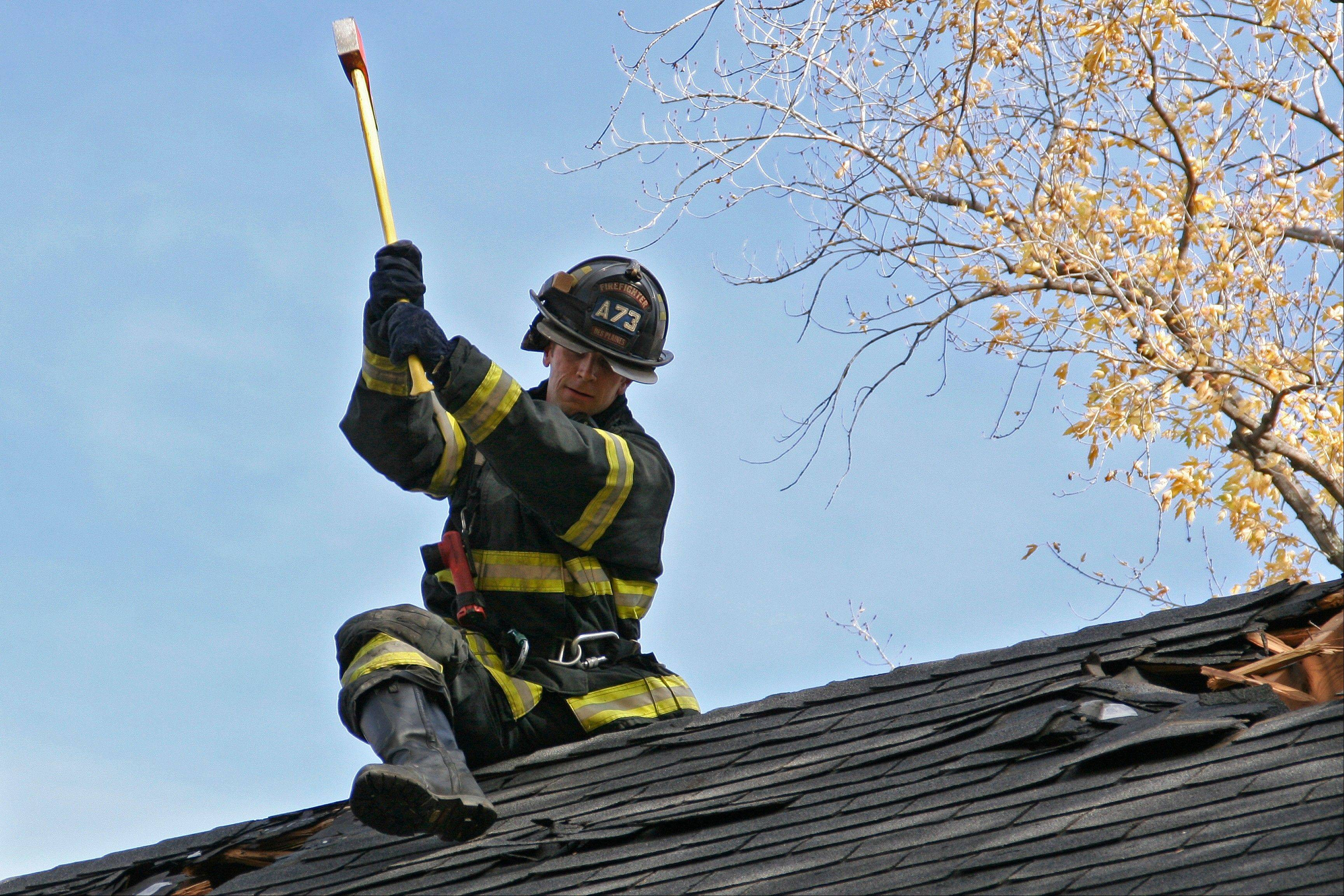 Des Plaines Fire Department personnel train on the roof.
