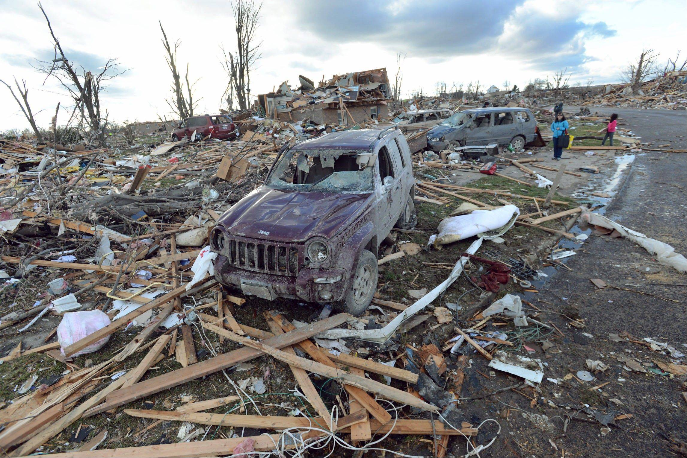 Demolished homes and vehicles in the Devonshire Subdivision in Washington, Ill., Sunday, Nov. 17, 2013. Intense thunderstorms and tornadoes swept across the Midwest, causing extensive damage in several central Illinois communities while sending people to their basements for shelter.