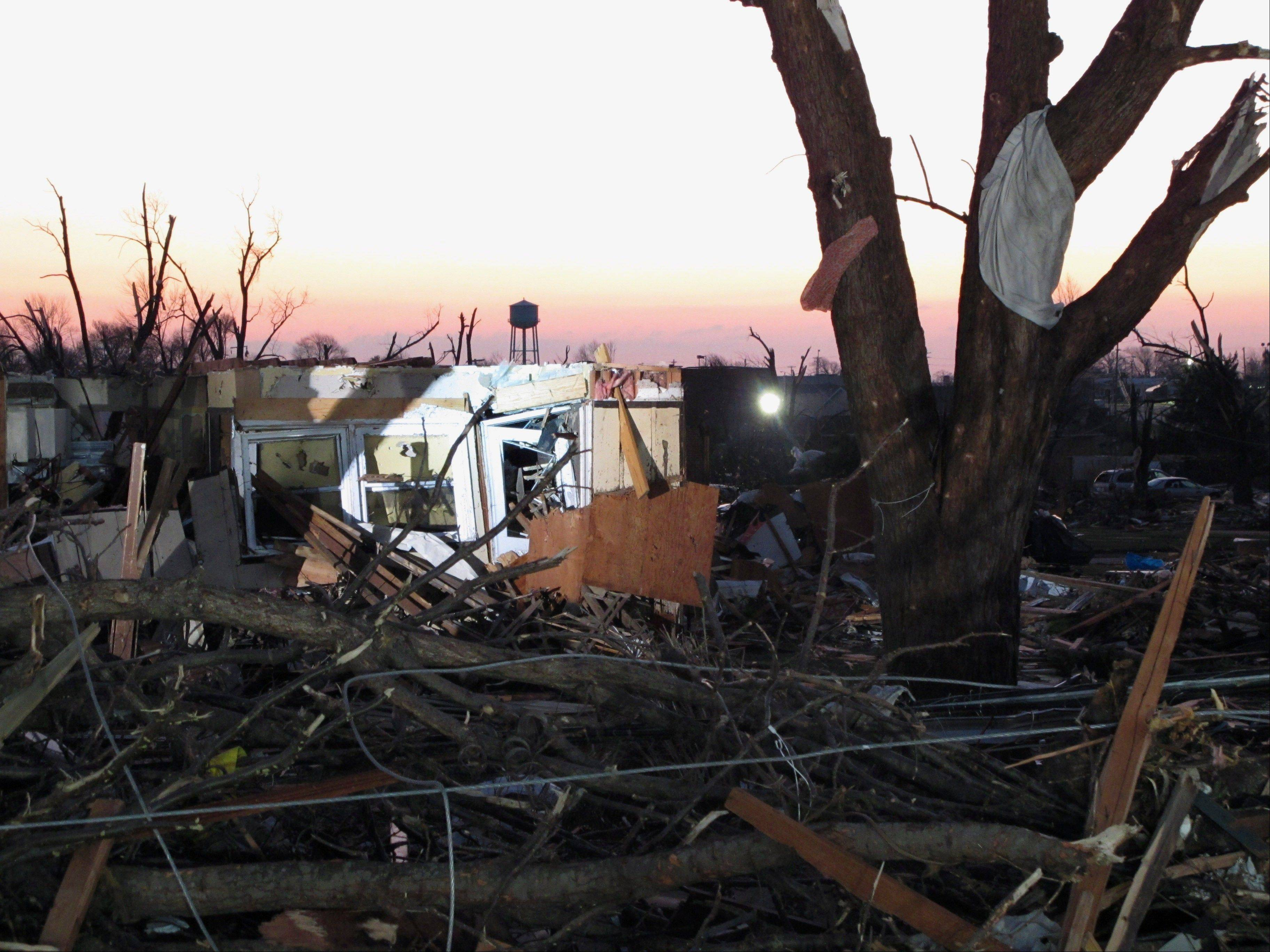 The rubble of a home in Washington, Ill., is seen early Monday, Nov. 18, 2013, after a tornado leveled hundreds of homes in the city the day before.