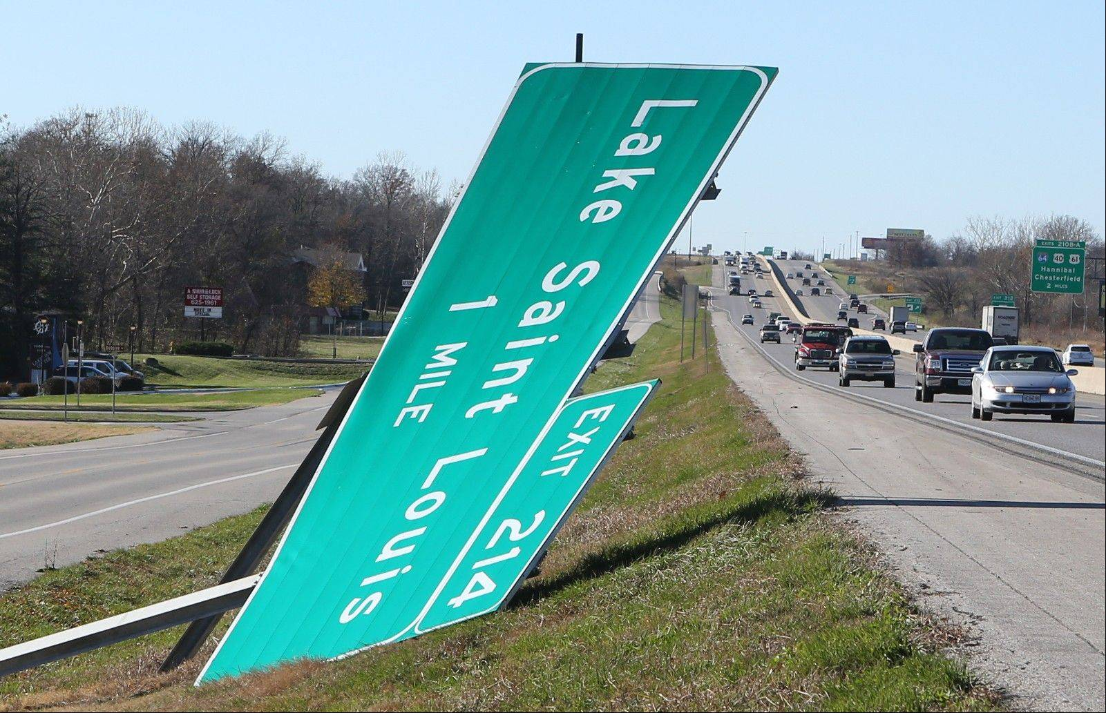 The Lake St. Louis sign on I-70 was knocked down on Sunday, Nov. 17, 2013, following the storm that raced through the area.
