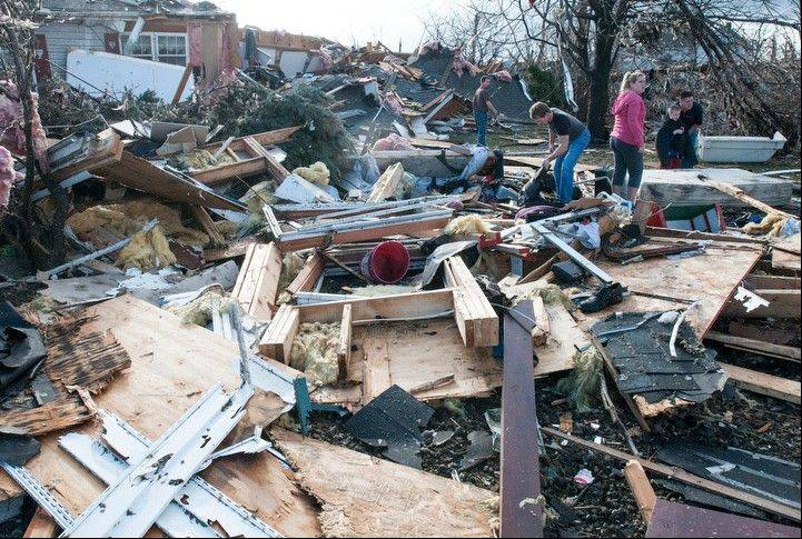 Residents search through debris following the likely tornado touch down in Gifford, Ill., on Sunday, Nov. 17, 2013.