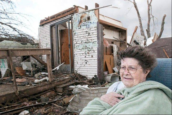 Pat Whitaker, 82, sits under a blanket in her nightgown outside her home waiting for help to come in Gifford, Ill. on Sunday, Nov. 17, 2013. Intense thunderstorms and tornadoes swept across the Midwest, causing extensive damage in several central Illinois communities while sending people to their basements for shelter.
